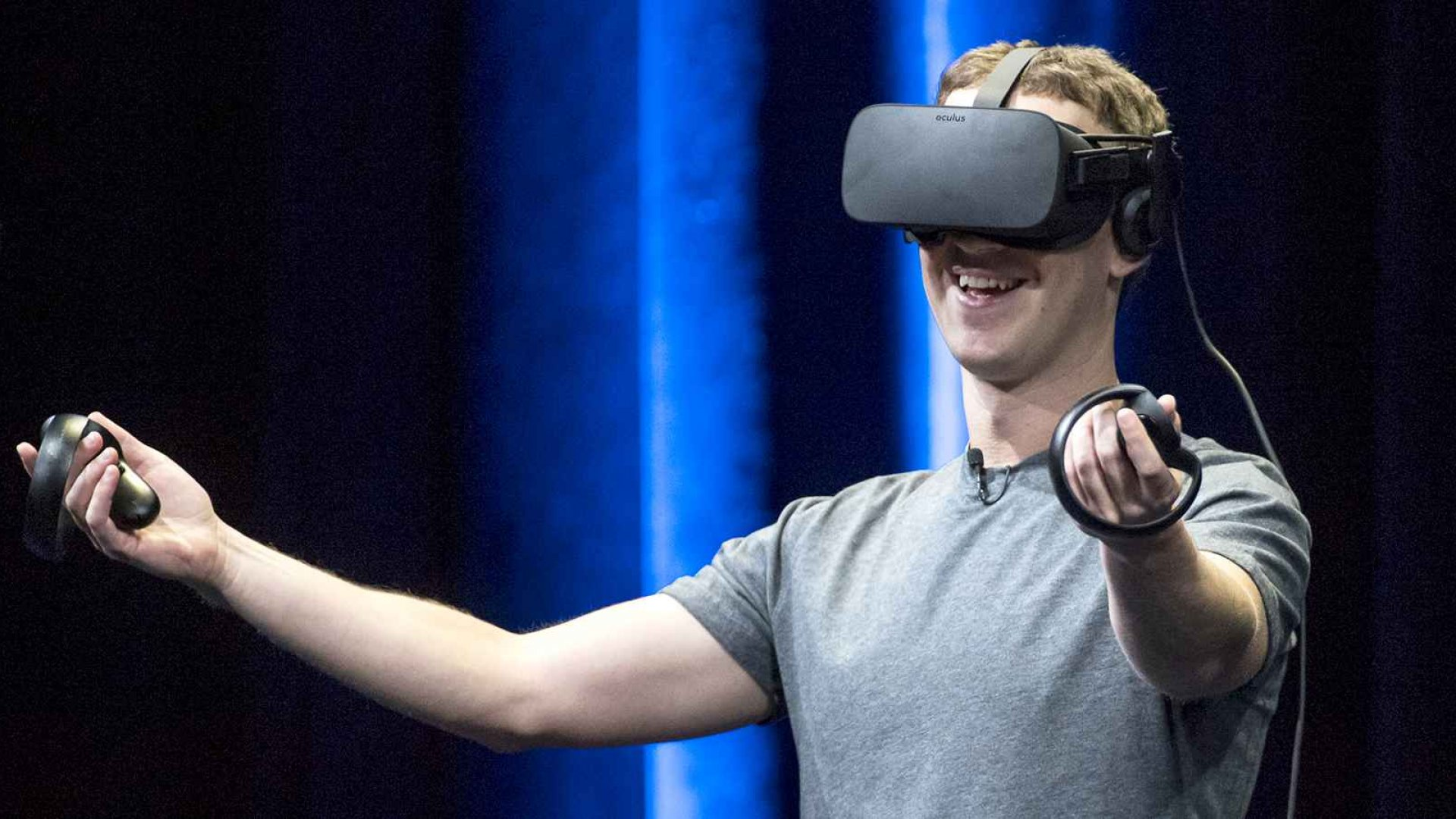 Mark Zuckerberg, chief executive officer and founder of Facebook Inc., demonstrates an Oculus Rift virtual reality headset and Oculus Touch controllers.