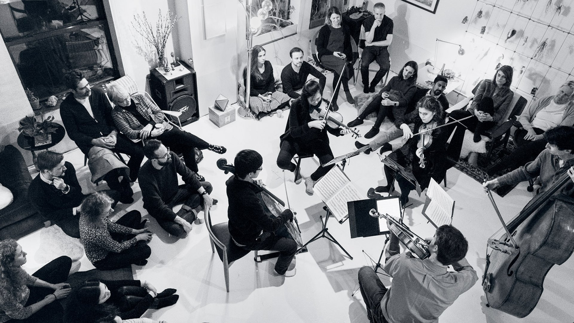 In a loft in Brooklyn's Dumbo neighborhood, a string quintet led by Christine Wu (on violin, top left) plays Dvorak's String Quintet No. 2, Op. 77. The other musicians are (clockwise) Emma Frucht (violin), Alex Bickard (double bass), George Meyer (viola), and Bryan Park (cello).