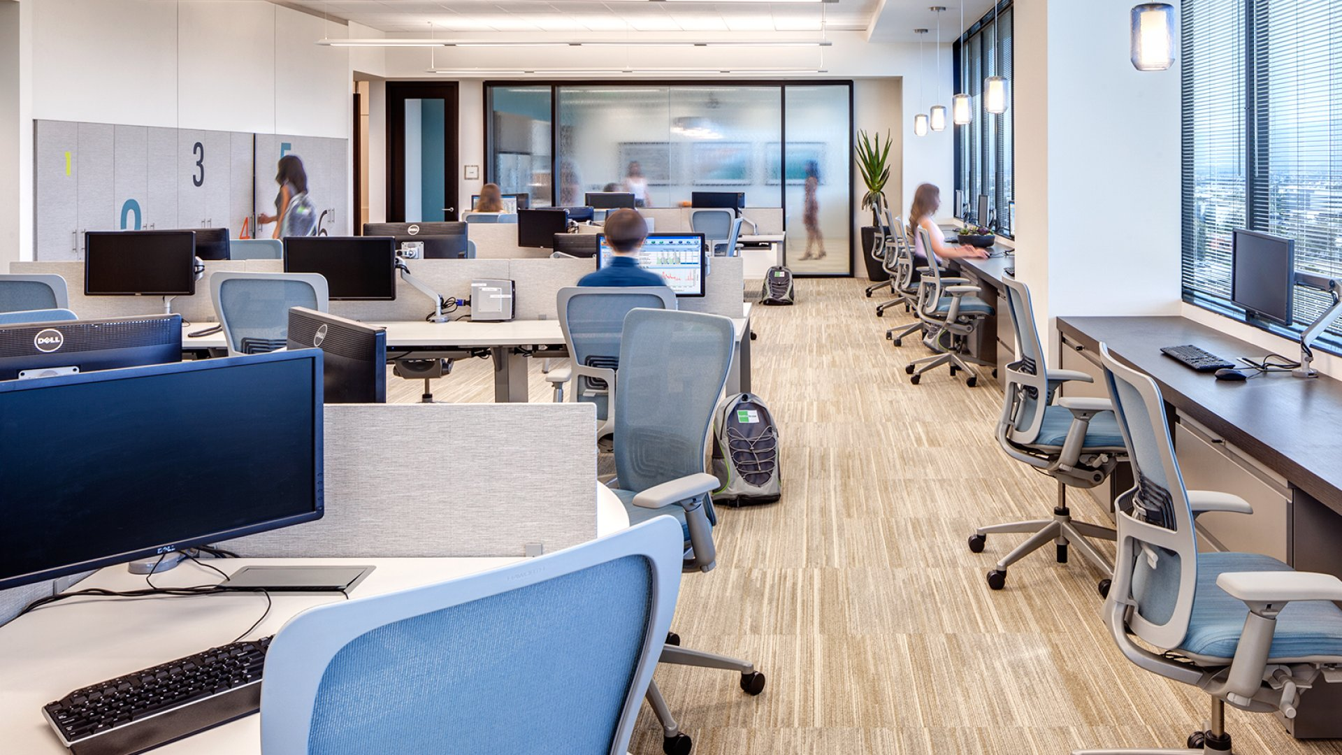 An open office H. Hendy Associates designed for the commercial real estate group Goodman.