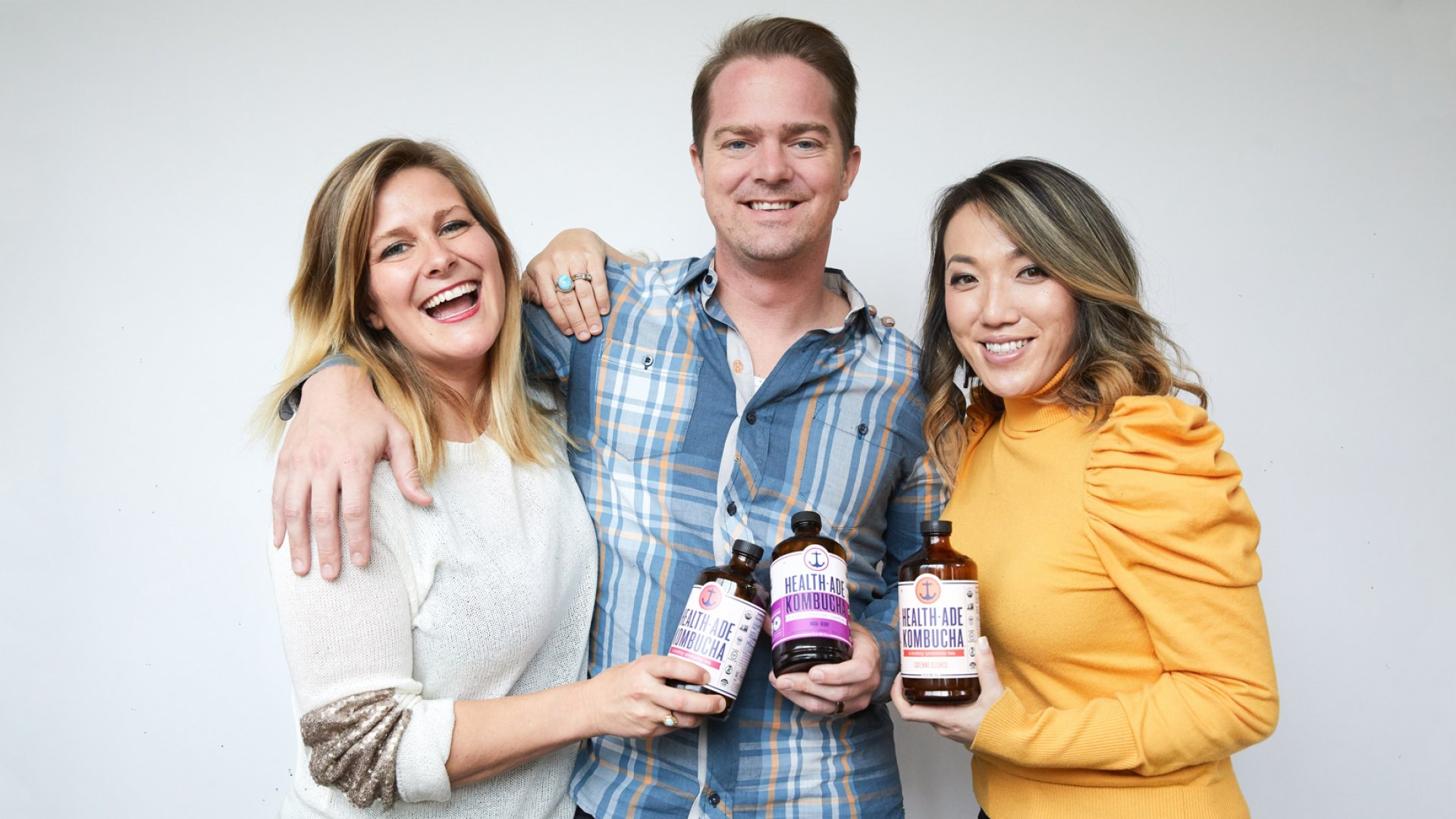Daina Trout (left), Justin Trout, and Vanessa Dew, co-founders of Health-Ade Kombucha.