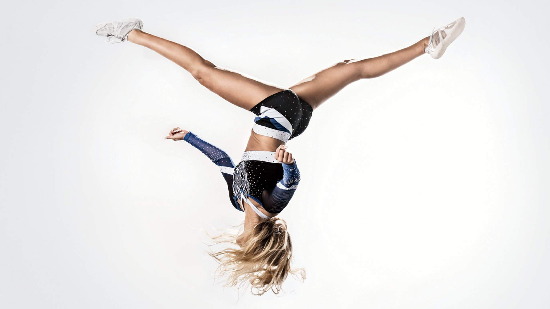 Rebel made couture a bigger part of a dowdy business. The company's in-house fashion designers work directly with teams to custom-make cheerleading uniforms.