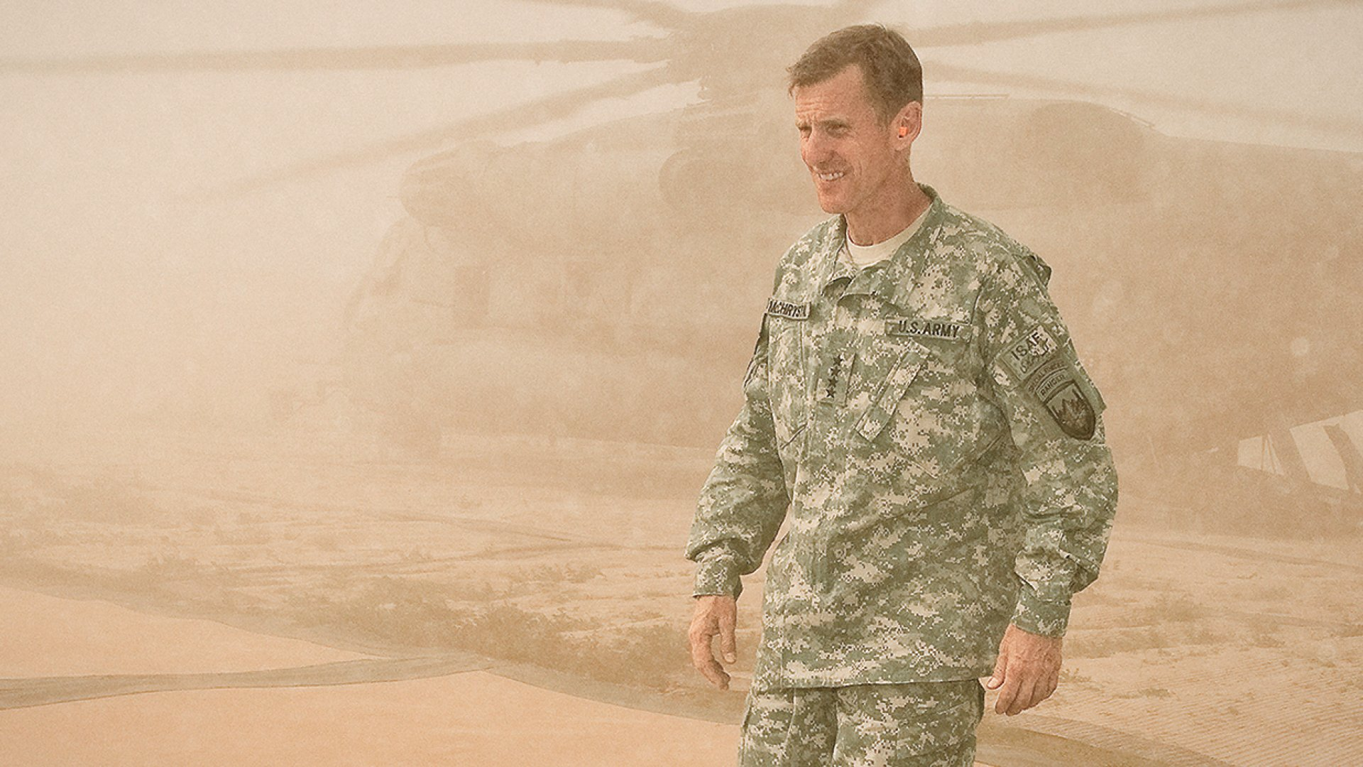 Sand and dust envelope McChrystal at Combat Outpost Sharp in the Garmsir District of Afghanistan, April 2010.
