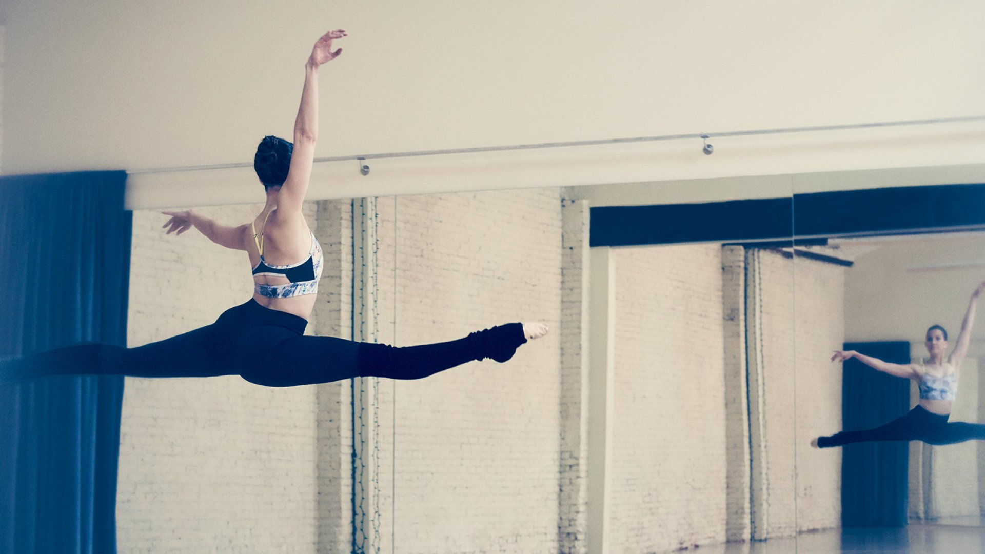 Katie Warner Johnson, at the apex of a grand jete, during a recent solo ballet workout in downtown Los Angeles.