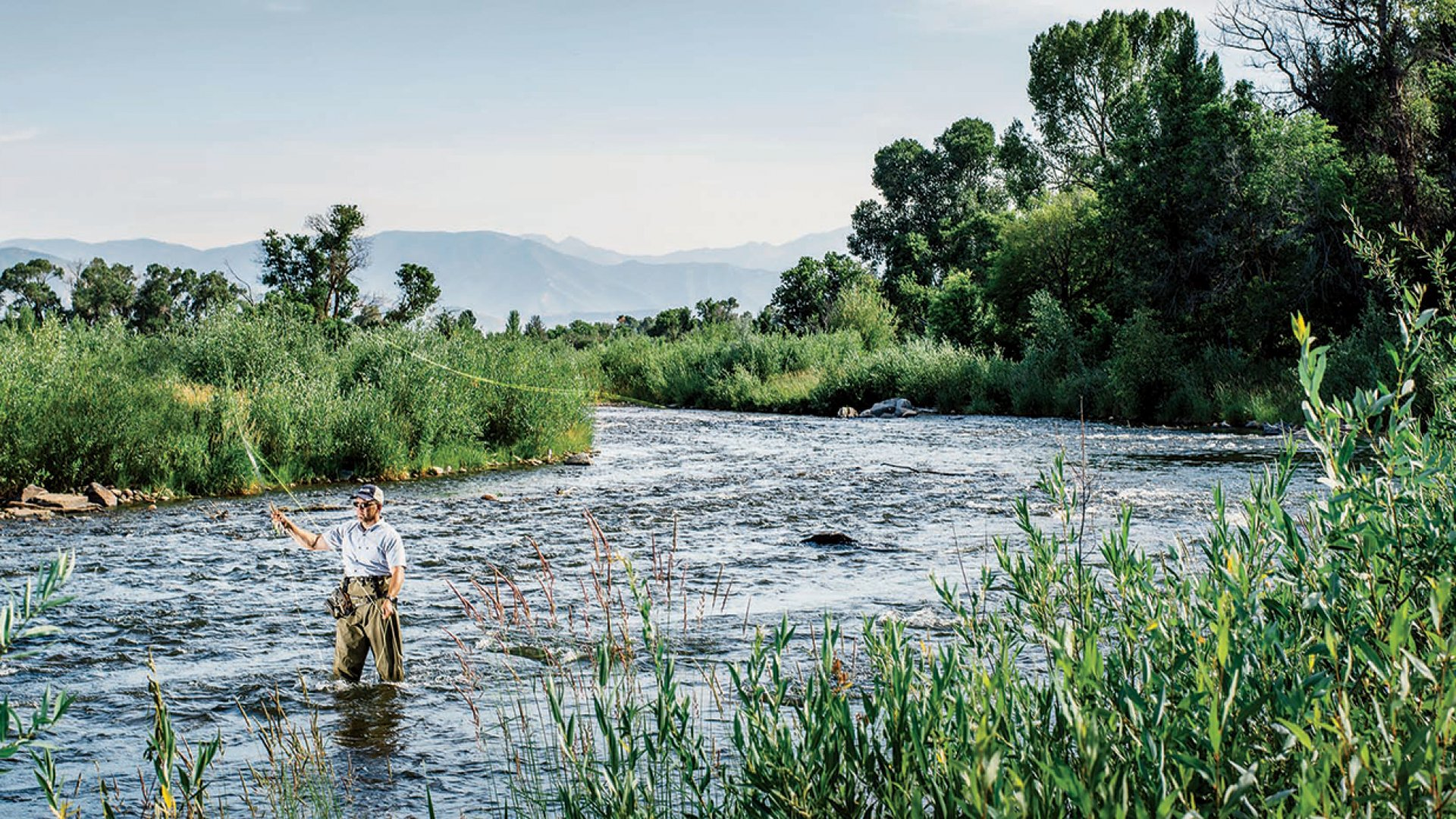 Kirk Feller fly fishing on Utah's Provo River. He gets out on the water about a dozen times a year.