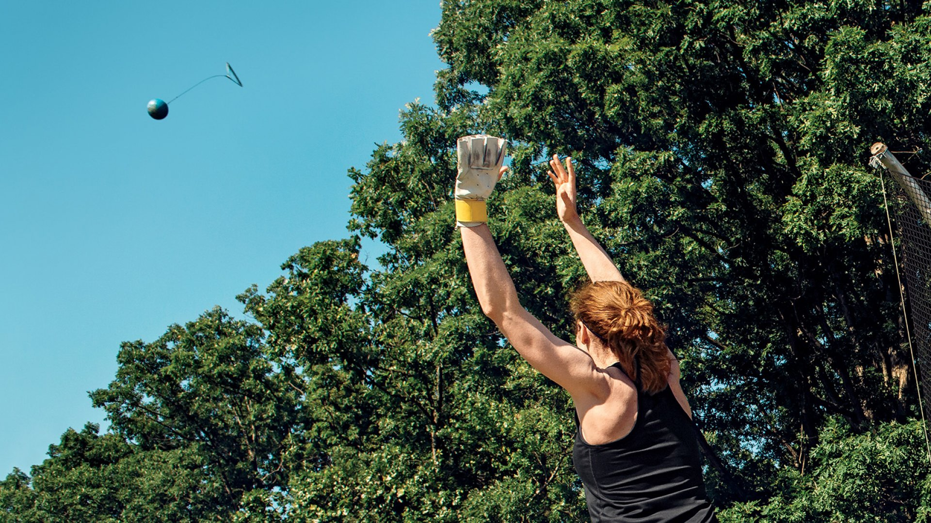 Beth Inglis at a hammer-throwing haunt in suburban Washington, D.C., launching her payload into space.