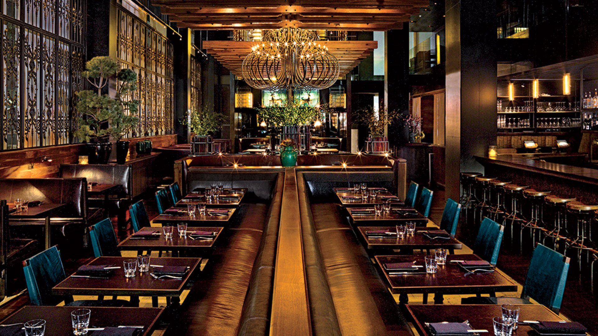 Classic AvroKO work at Manhattan's Zengo restaurant. The rich leather and wood tones, golden light, ceiling timbers, and eclectic mix of custom furniture and found objects are hallmarks of the firm's design portfolio.