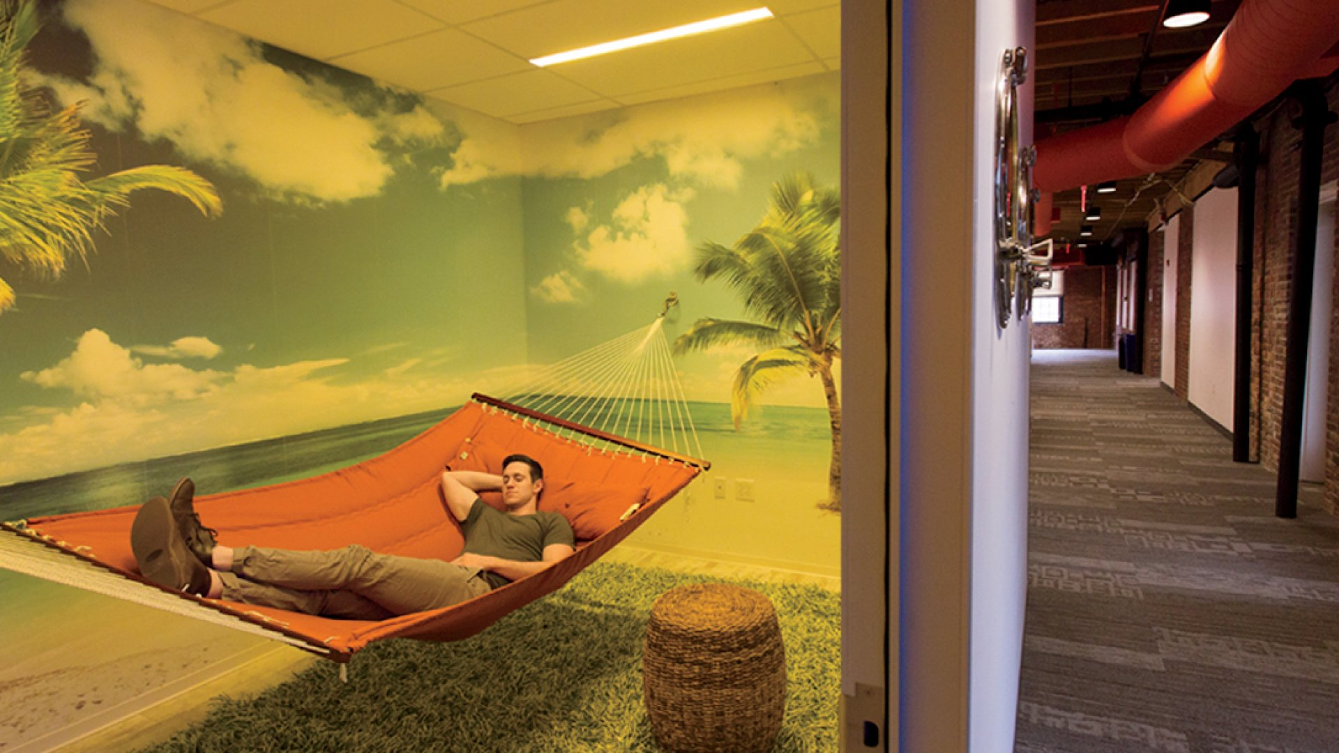 It's not just a nap - it's a total change of scene. HubSpot's new quiet room gives employees a peaceful beach background while they relax in hammocks.