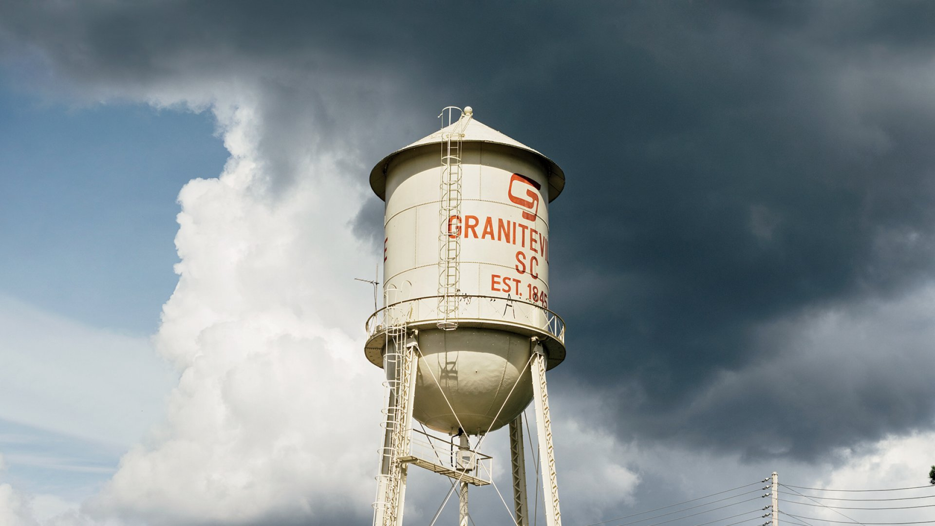 Graniteville's iconic water tower stands above the grounds of the town's old textile mills. Like the mills, the water tower fell into disrepair until Recleim opened a next-generation recycling plant in 2012.