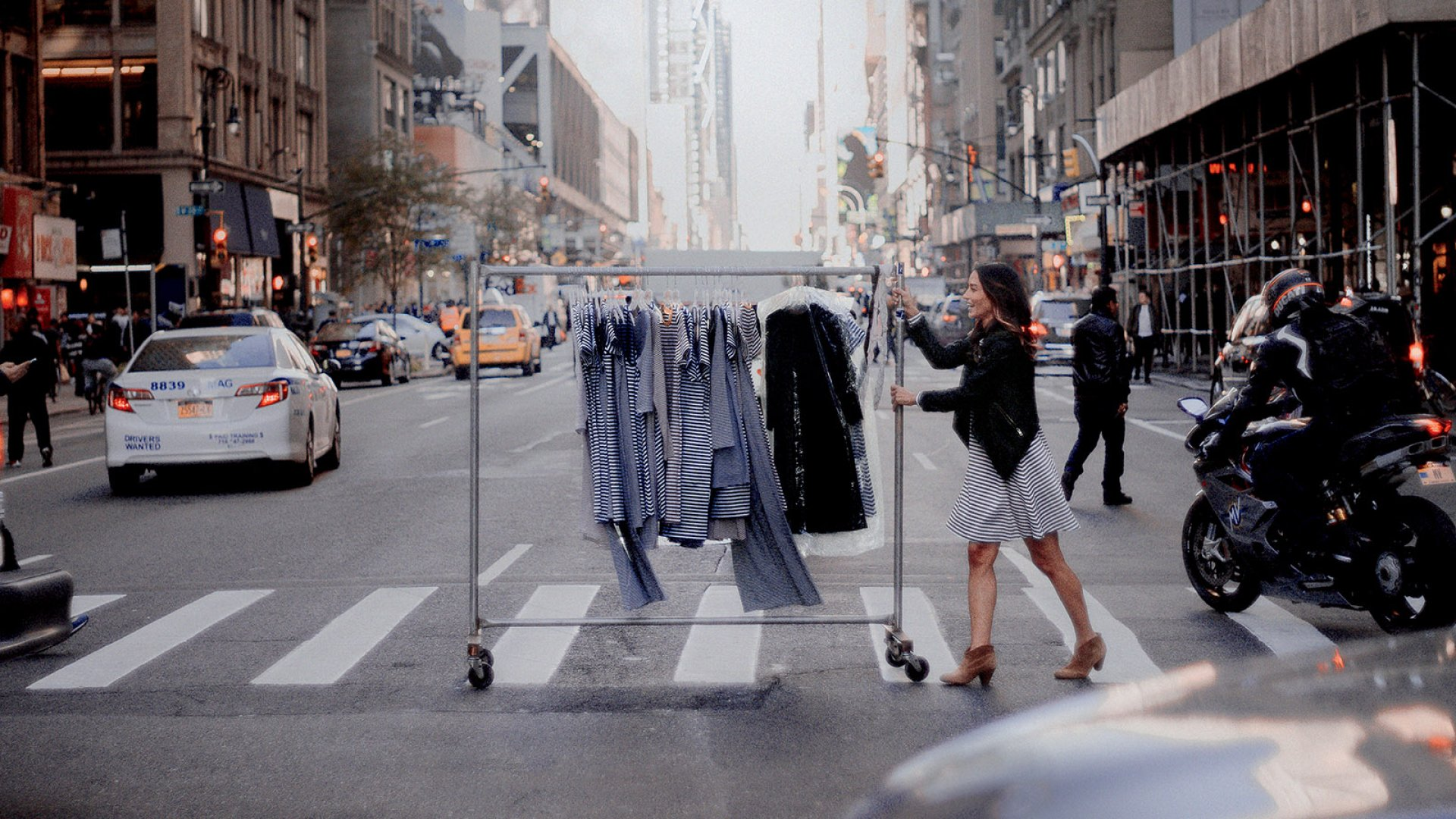 Kristin Celano rolls a rack of her sports-team-inspired apparel in New York City's garment district. After a decade as a tech executive, Celano could no longer delay her dream of becoming an entrepreneur and started women's clothing company JaneHudson. The rate of women starting businesses rose in 2016.