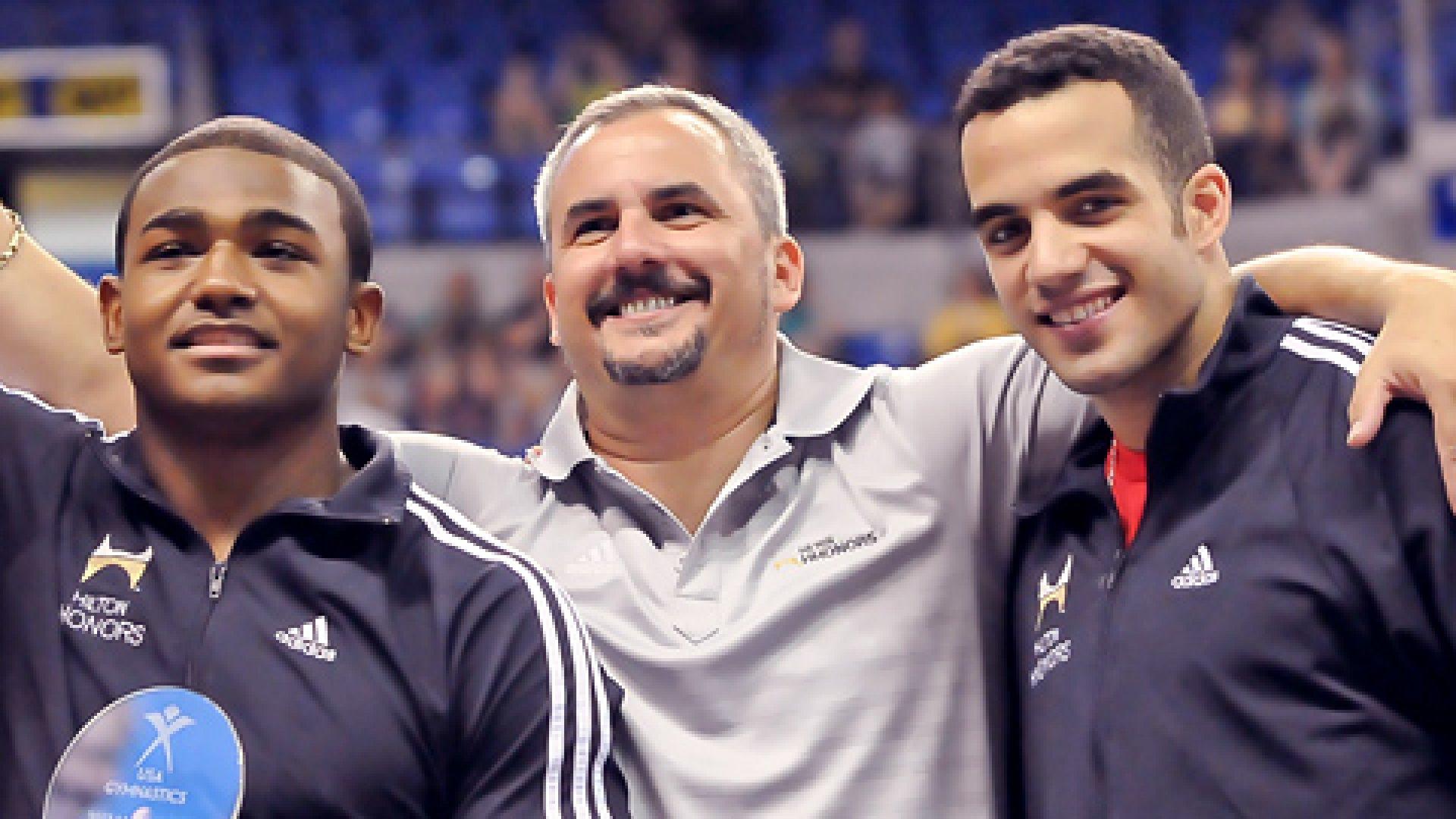 Yin Alvarez (center), with son and gymnast Danell Leyva (right)