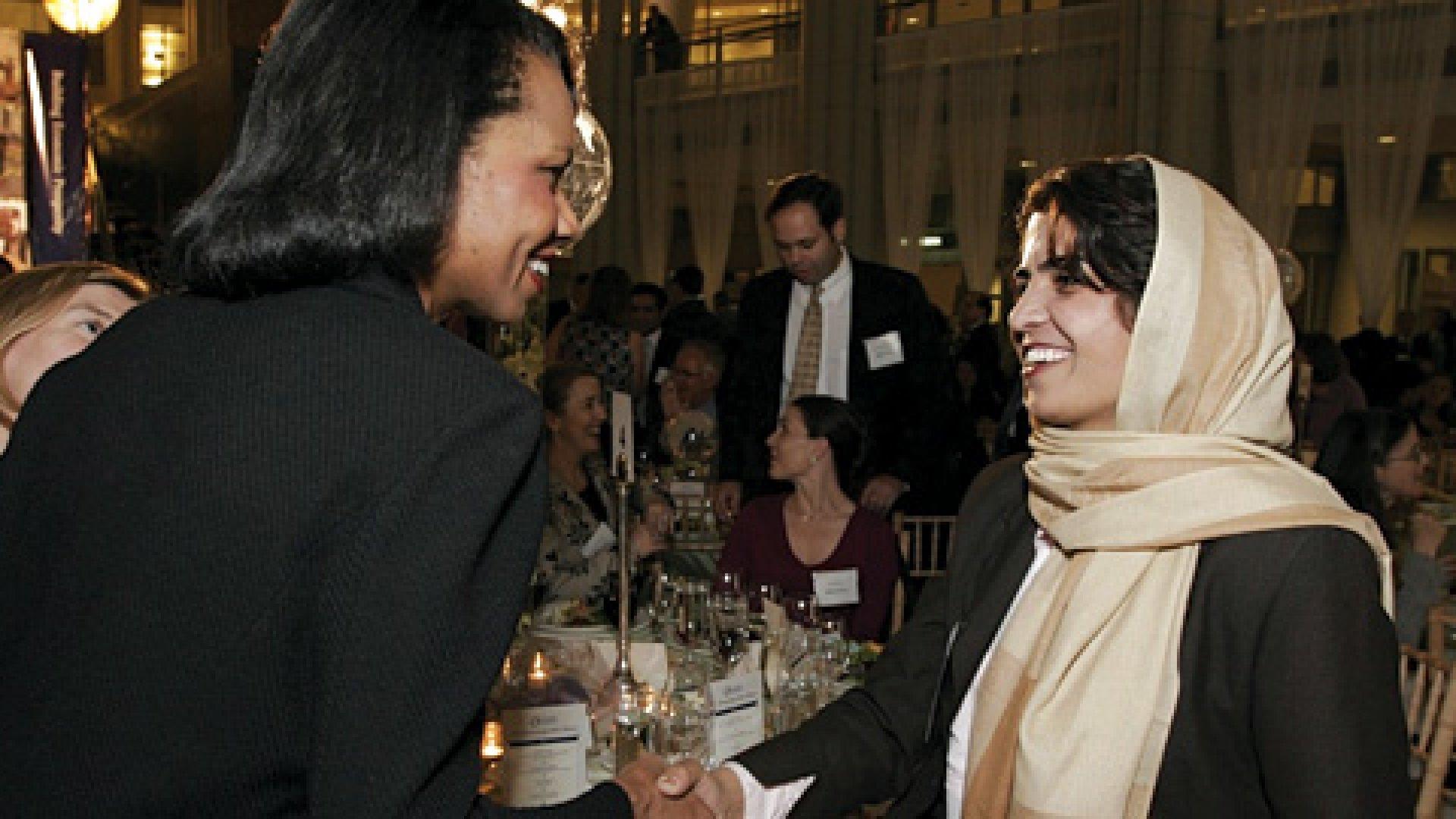 Kamila Sidiqi receiving congratulations from Condoleezza Rice.