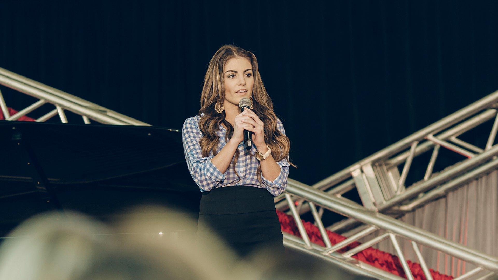 Student Maid CEO Kristen Hadeed speaking at TEDx St. Louis Women.