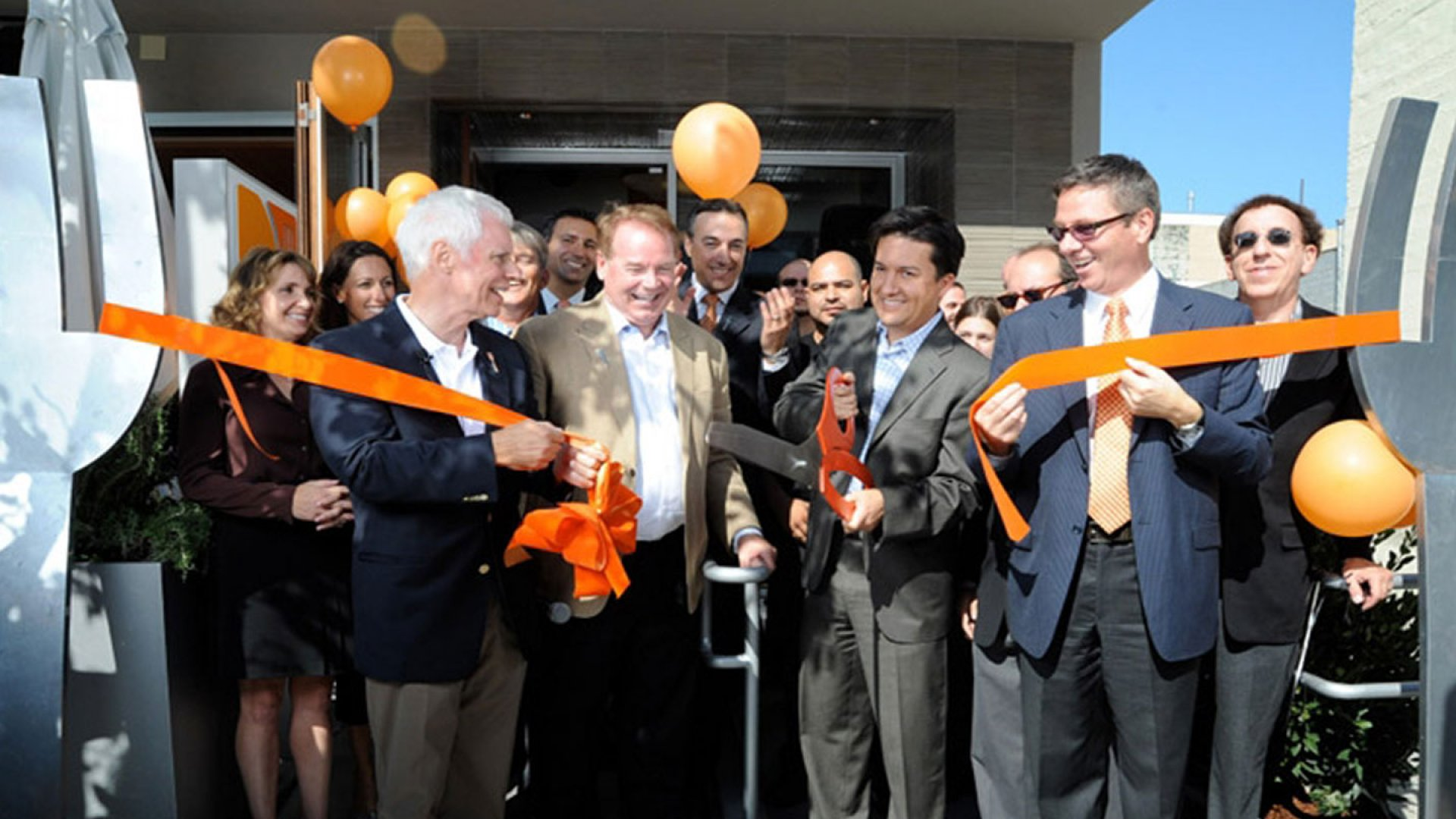 Mike Roberts participates in his company's ribbon cutting ceremony in Palo Alto, Calif. in 2011
