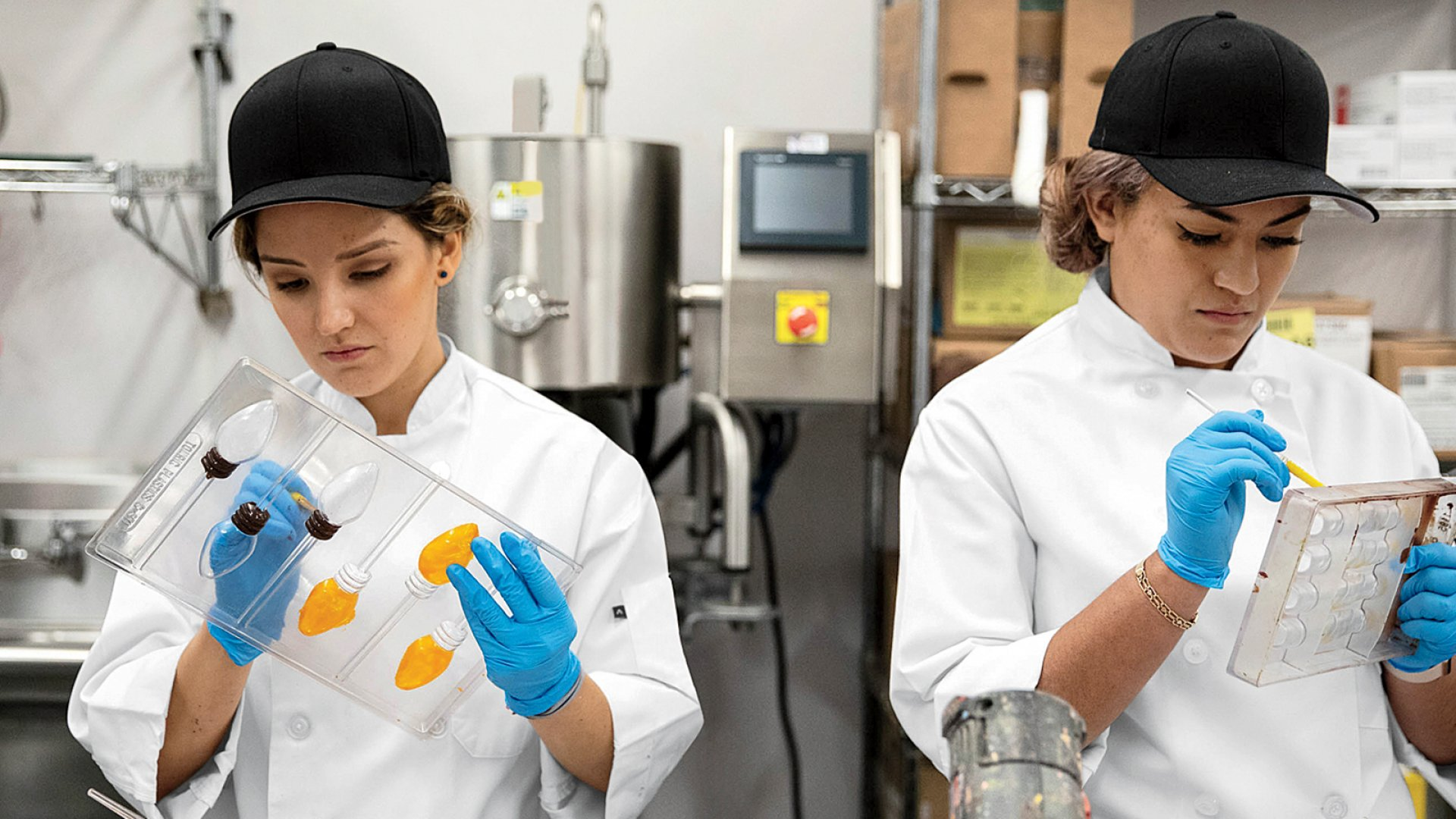 Maggie Louise Confections' employees hand paint clear chocolates molds.