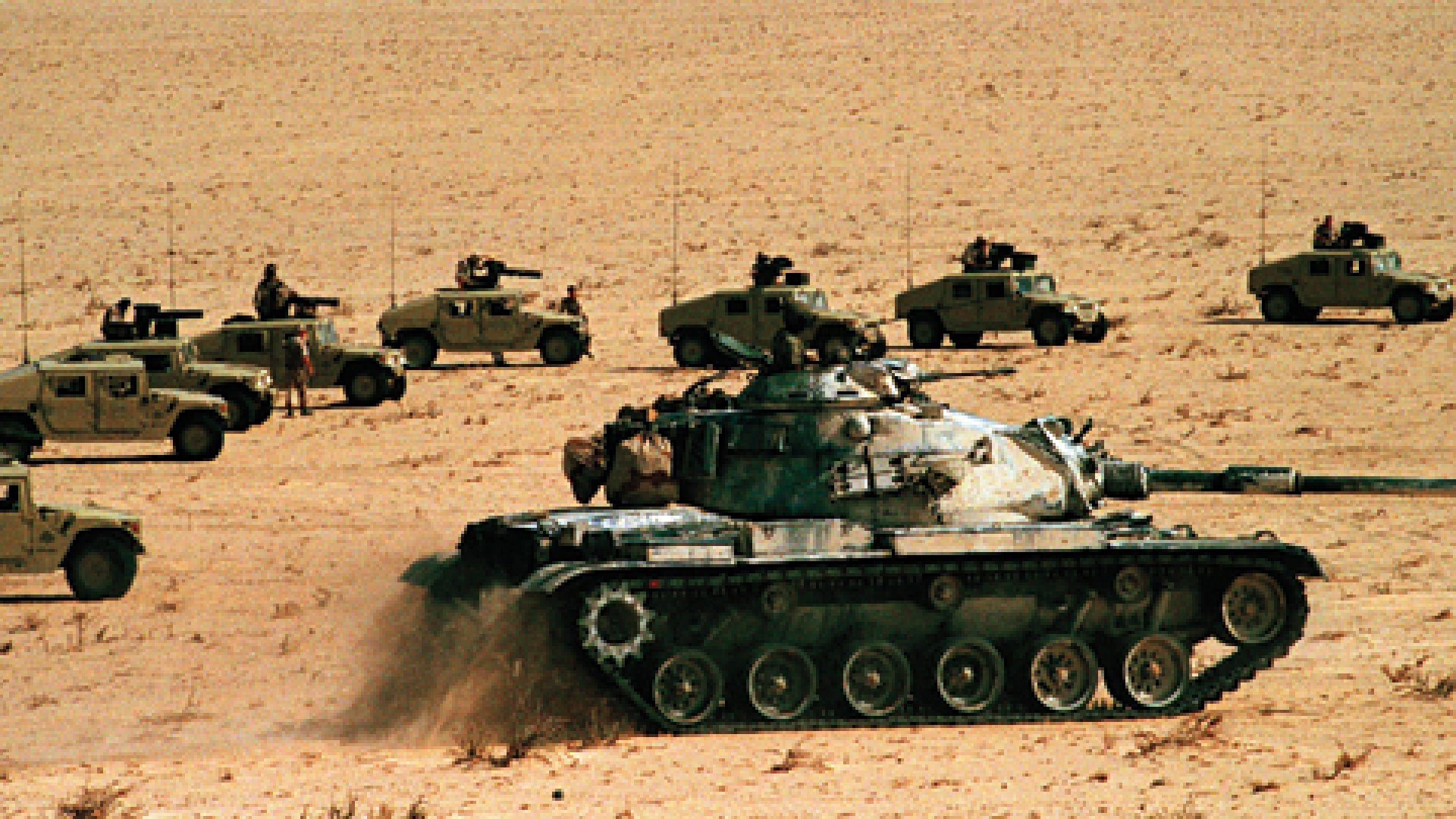 A Marine M-60 tank leads an assault of Humvee's mounted with Tow anti-tank missile launchers during an exercise in Saudi Arabia.