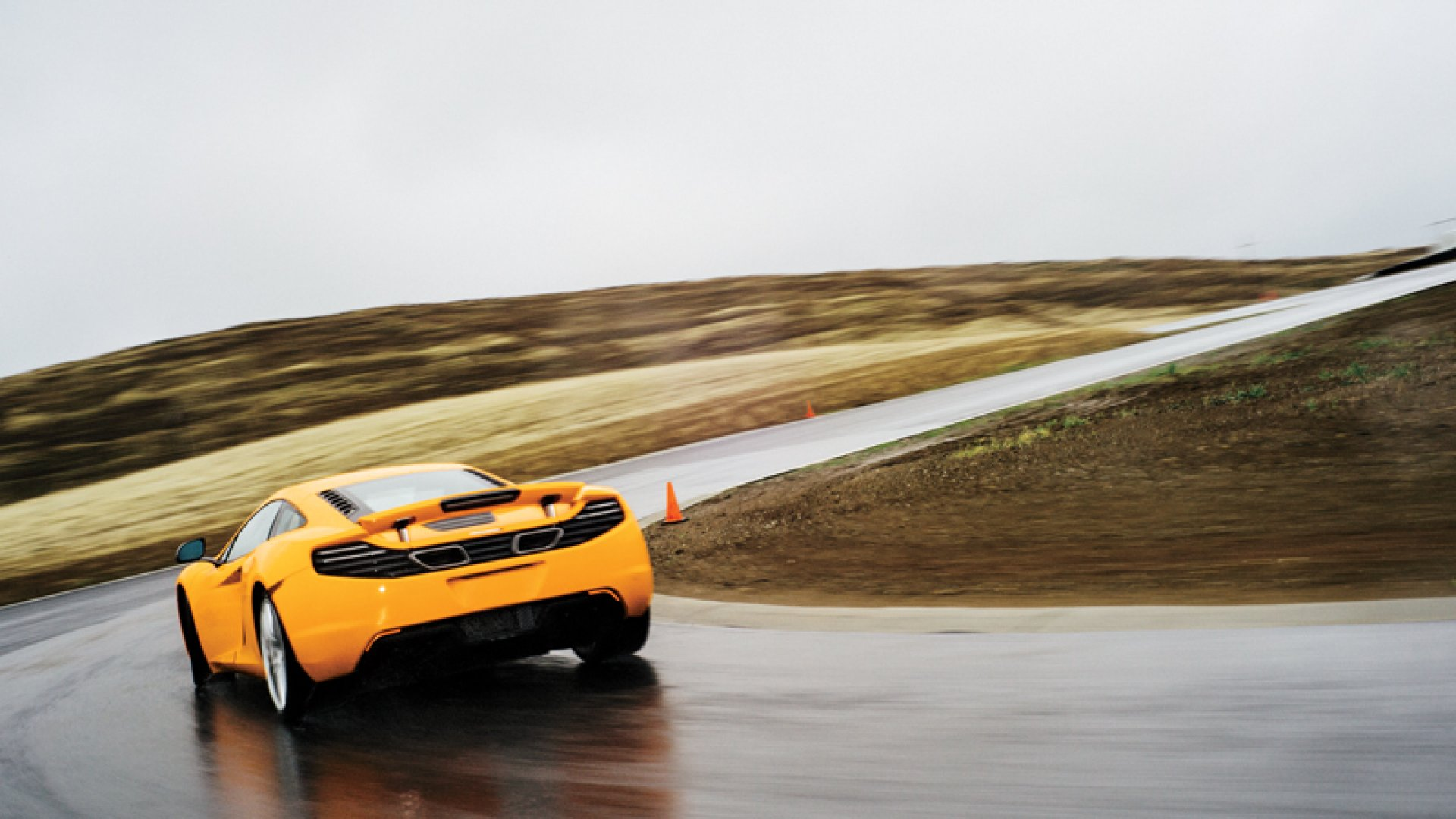 Daniel Ha piloting a McLaren MP4-12C at Thunderhill Raceway in Willows, California.
