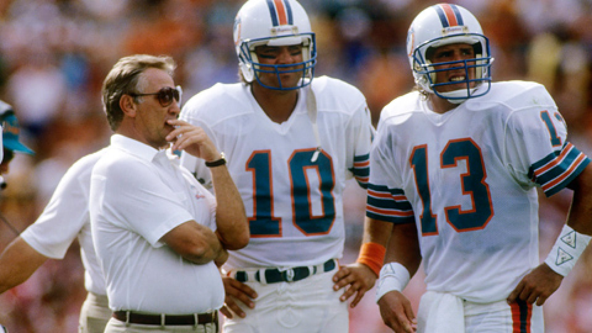 Head Coach Don Shula talks with quarterbacks Dan Marino #13 and Don Strock #10 circa mid 1980's.