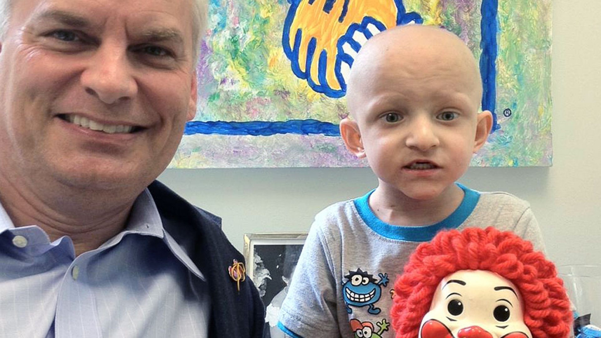 <strong>Serving the world</strong> Oie Osterkamp at Ronald McDonald House with Daniel, who is 4.