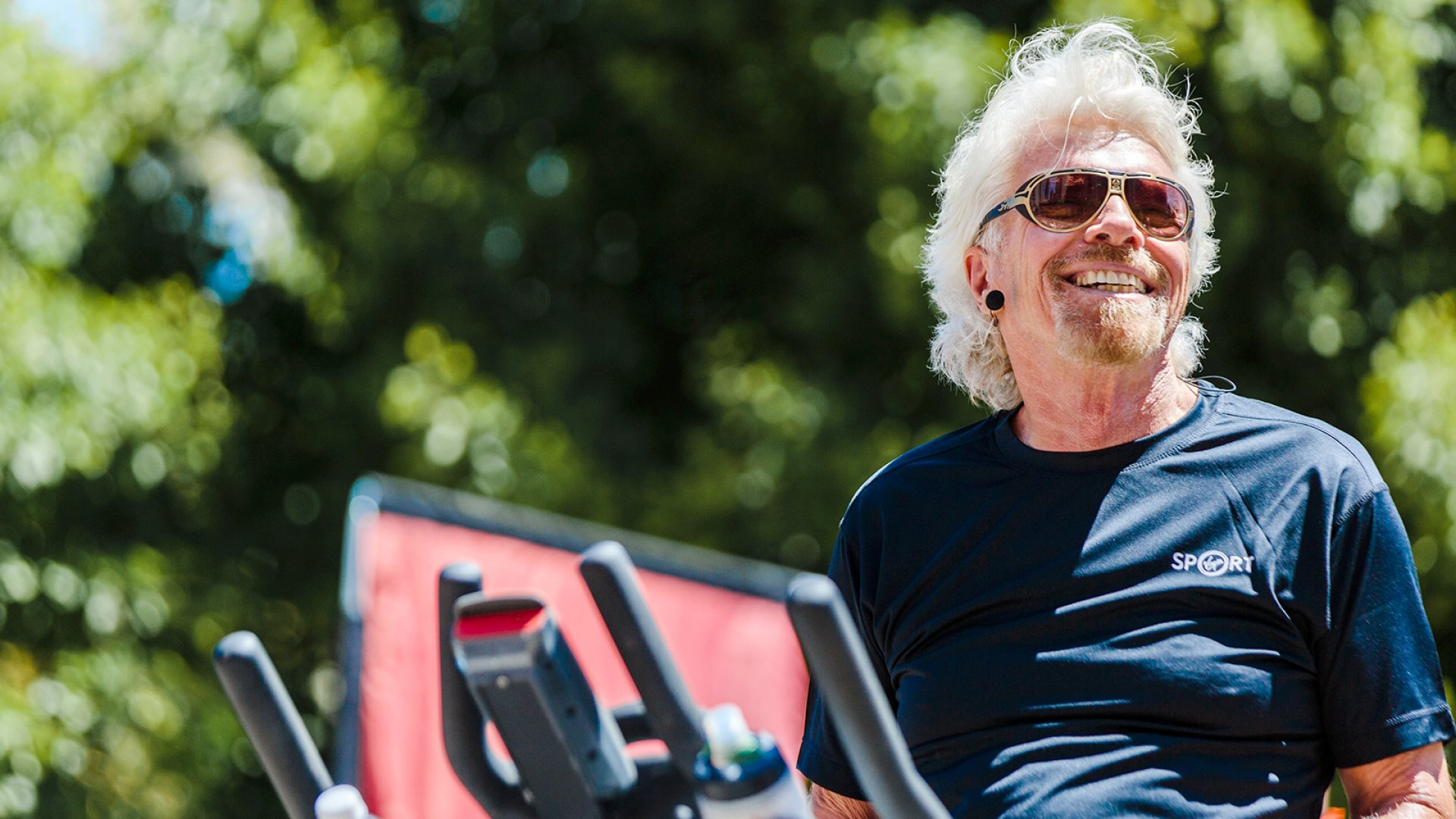 "In true Virgin Sport spirit, Sir Richard Branson announced the launch of the red-hot fitness festival, Virgin Sport San Francisco, while pedaling on a spin bike at the world's first ""Press Conference on the Move."