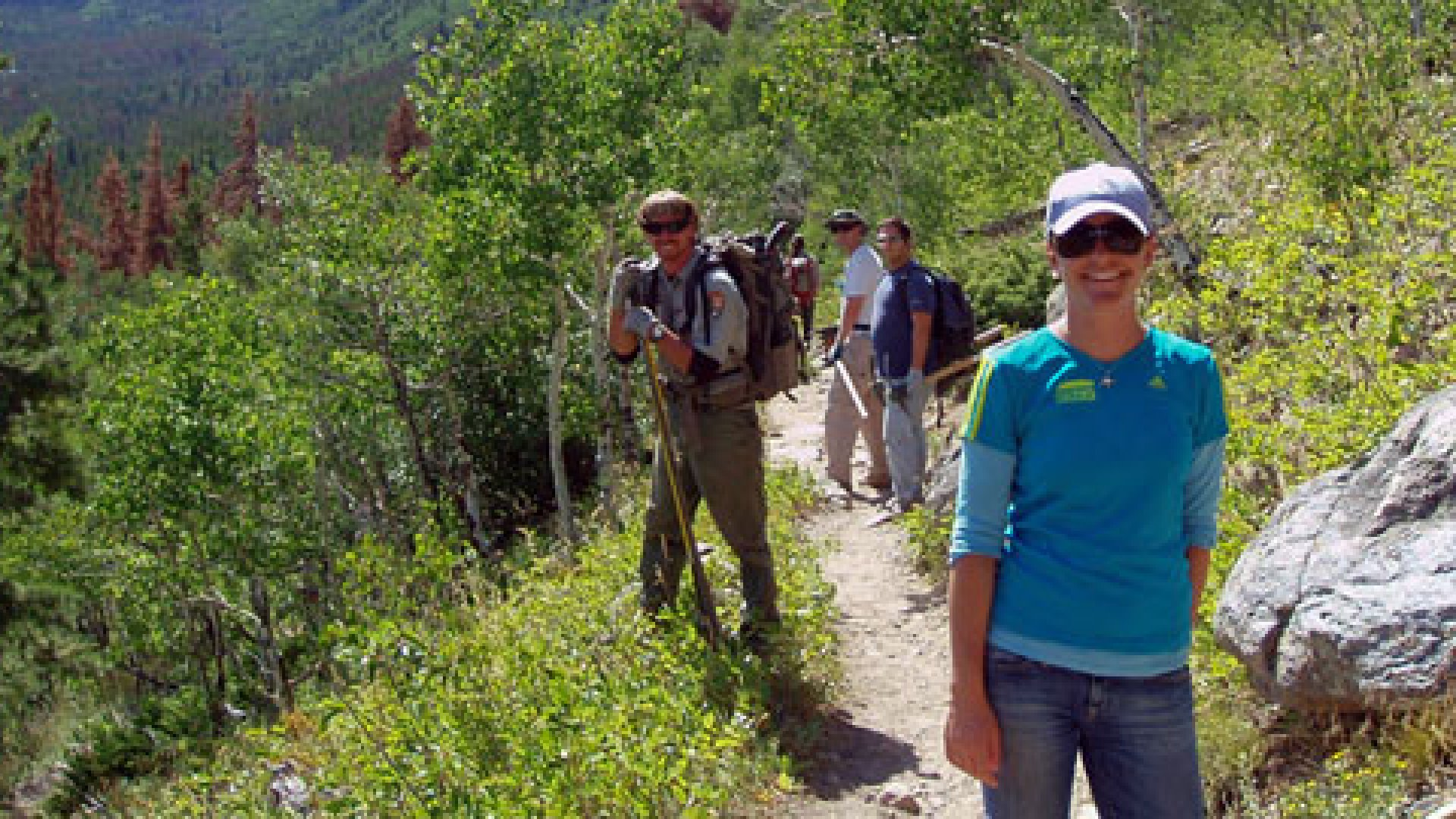 Readytalk employees cleaning up a trail in Rocky Mountain National Park last August in Estes Park, Colo.