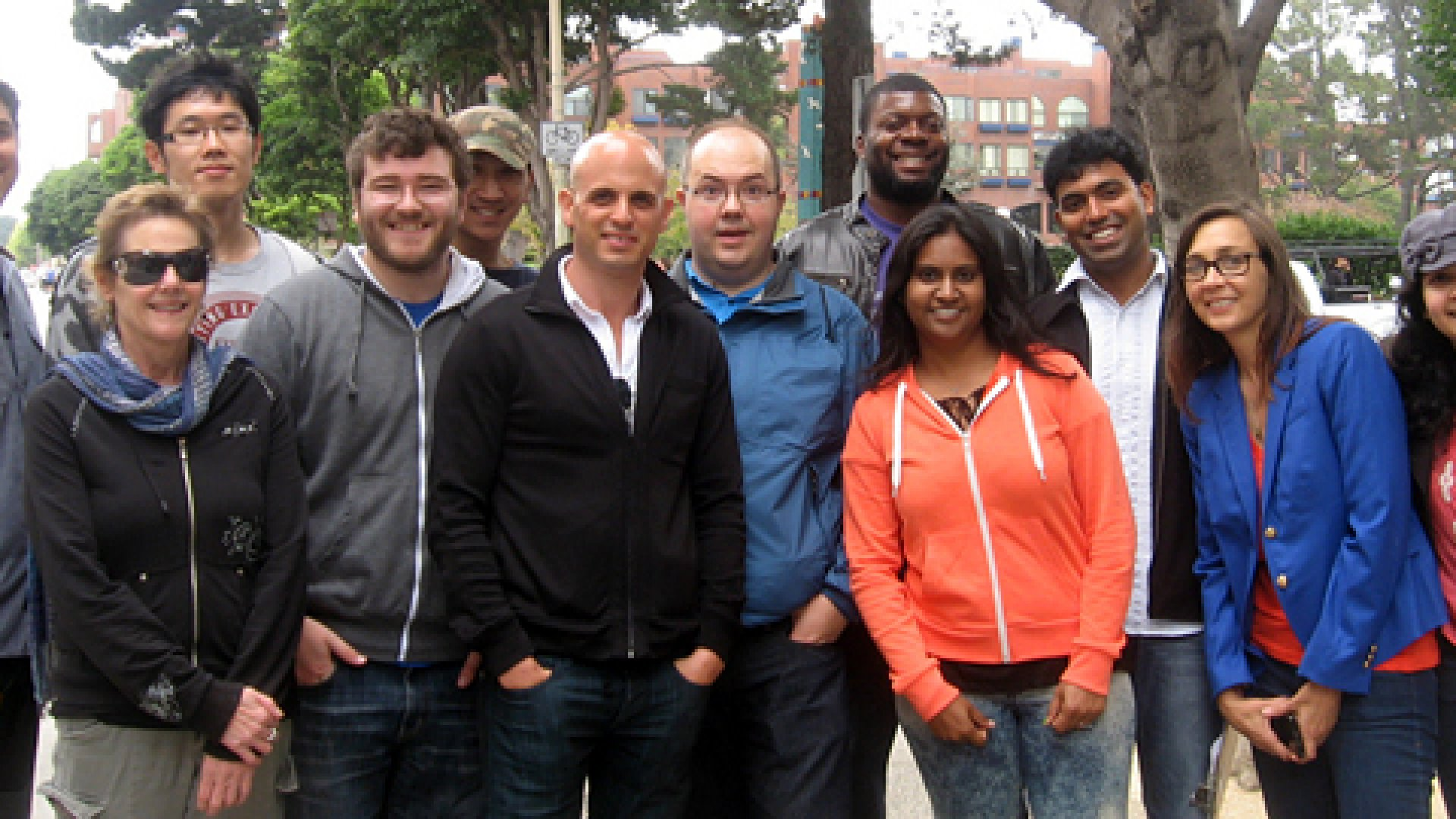 Regpack's employees will be left in limbo if their CEO, Asaf Darash (center, in black), must leave the country.