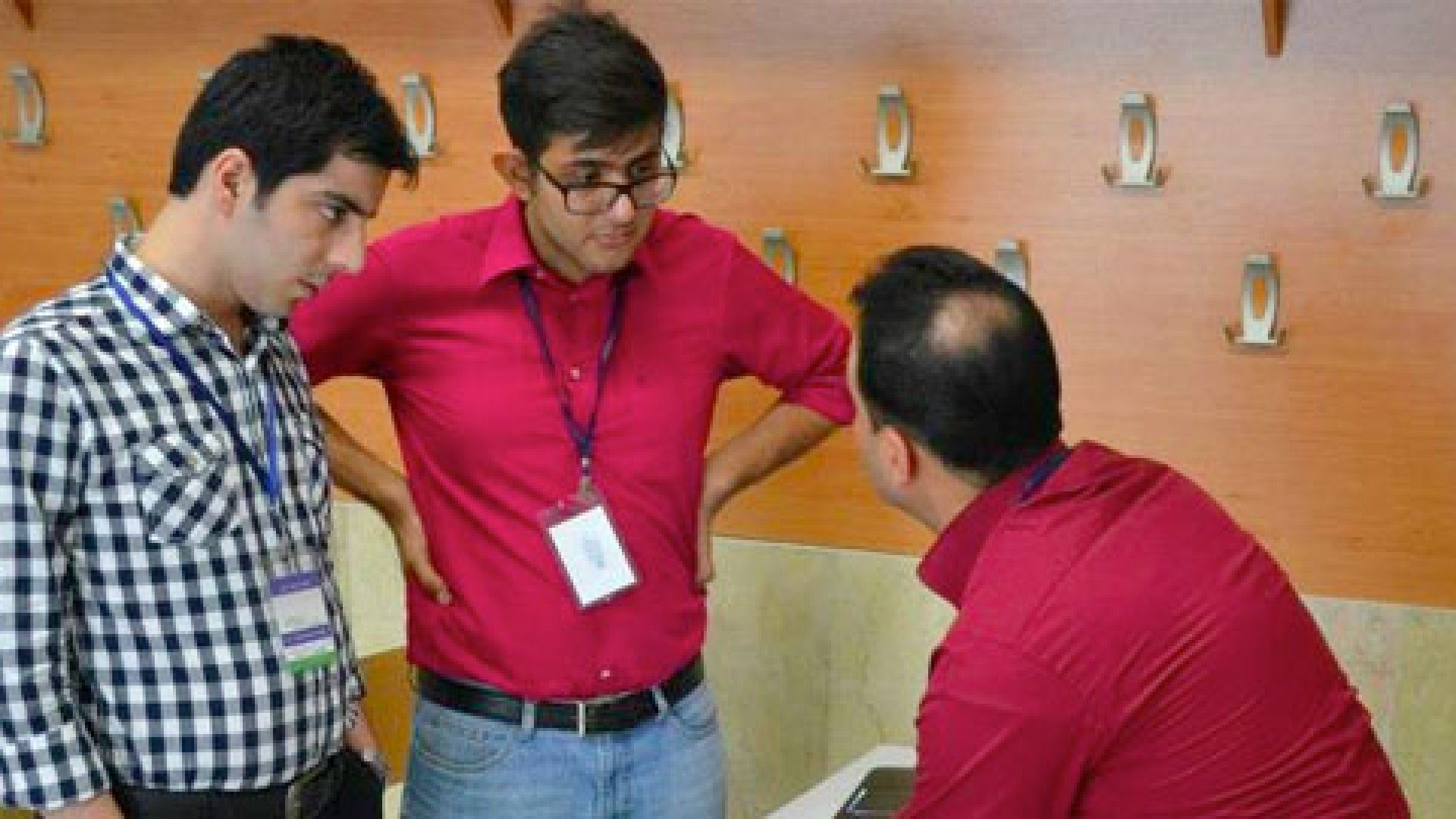 Teams collaborate on their ideas at Iran's first Startup Weekend.
