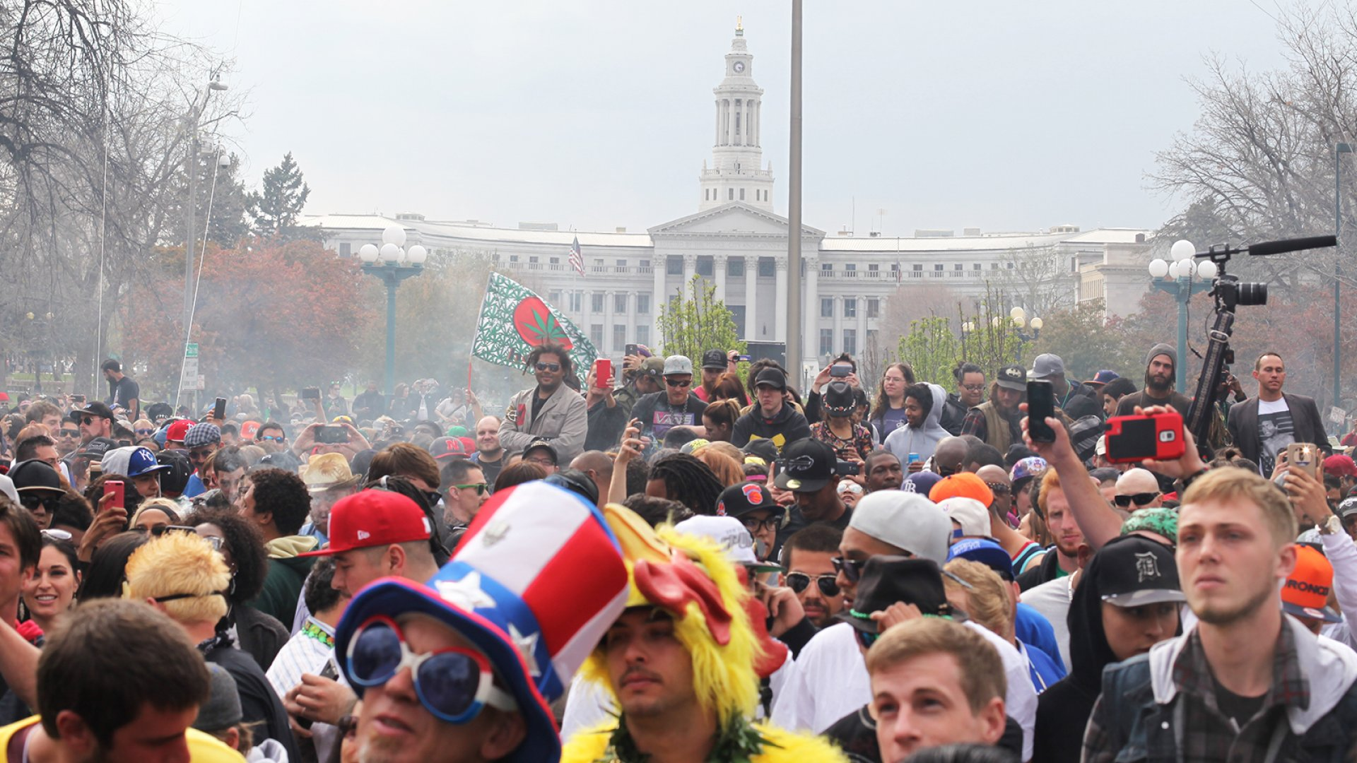 Revelers light up in Denver on 4/20, the pot holiday.