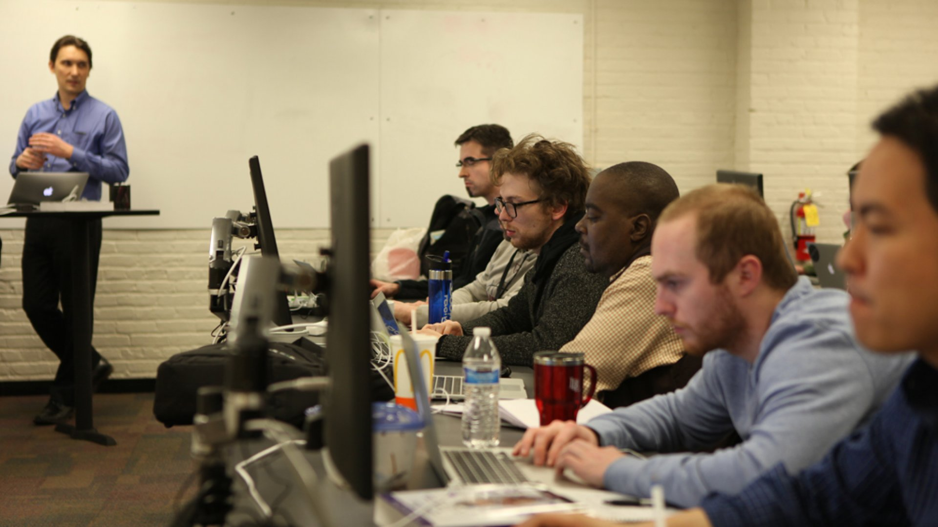 After 19 students at Devschool lost $100,000 in tuition, the coding bootcamp market has been in a state of self-evaluation. Above, Tech Elevator chief academic officer David Wintrich leads a software engineering class.