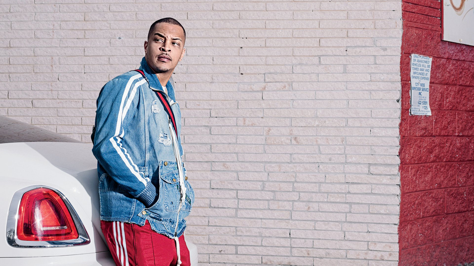 T.I., in front of the recently shuttered Bankhead Seafood restaurant, in the Atlanta neighborhood where he grew up. He's bought the building, as part of his Buy Back the Block redevelopment initiative.