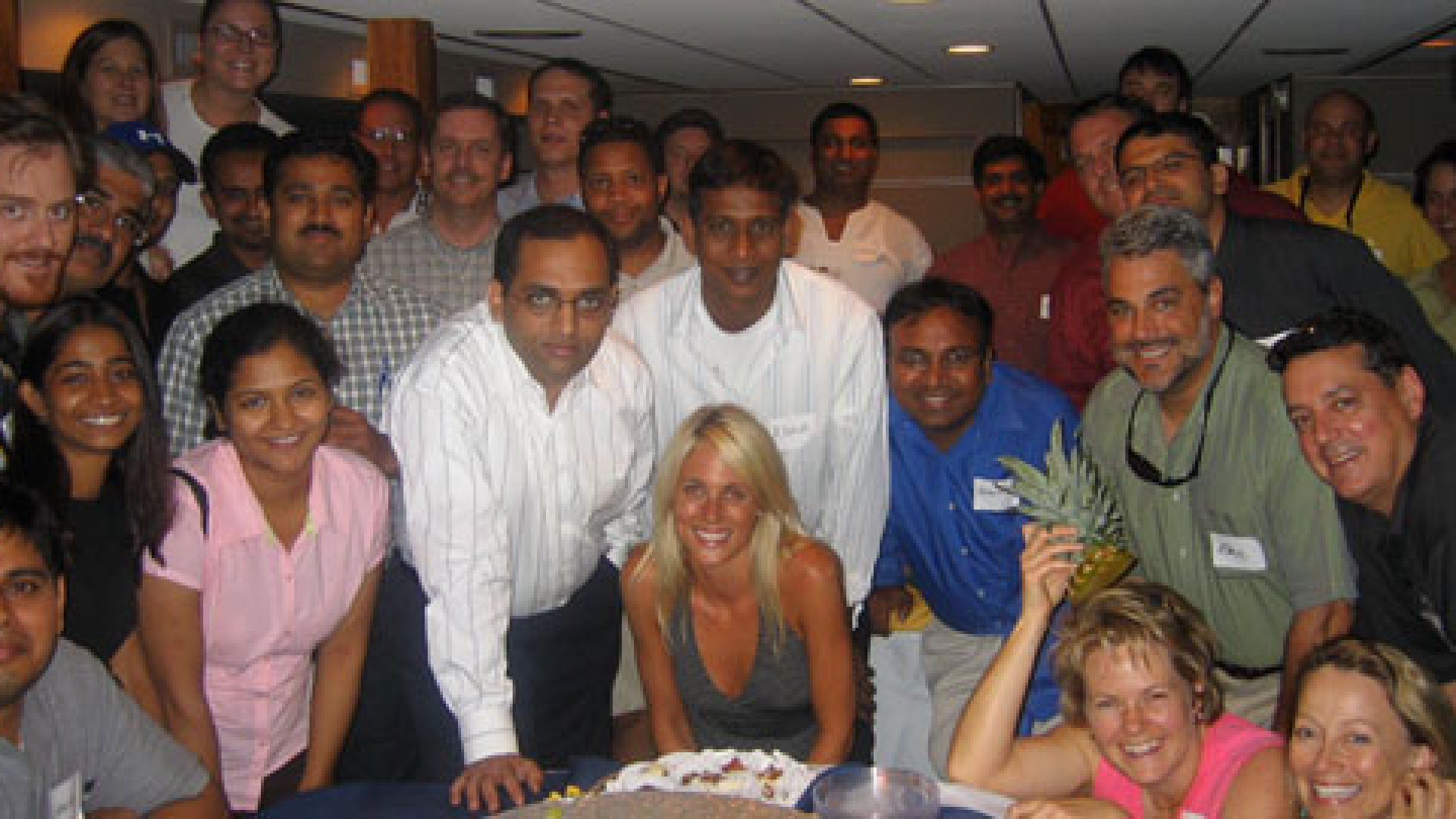 At their homey office and at regular special events such as this evening dinner cruise, employees of The Squires Group are considered family by CEO Nancy Squires (pictured on the far right bottom).