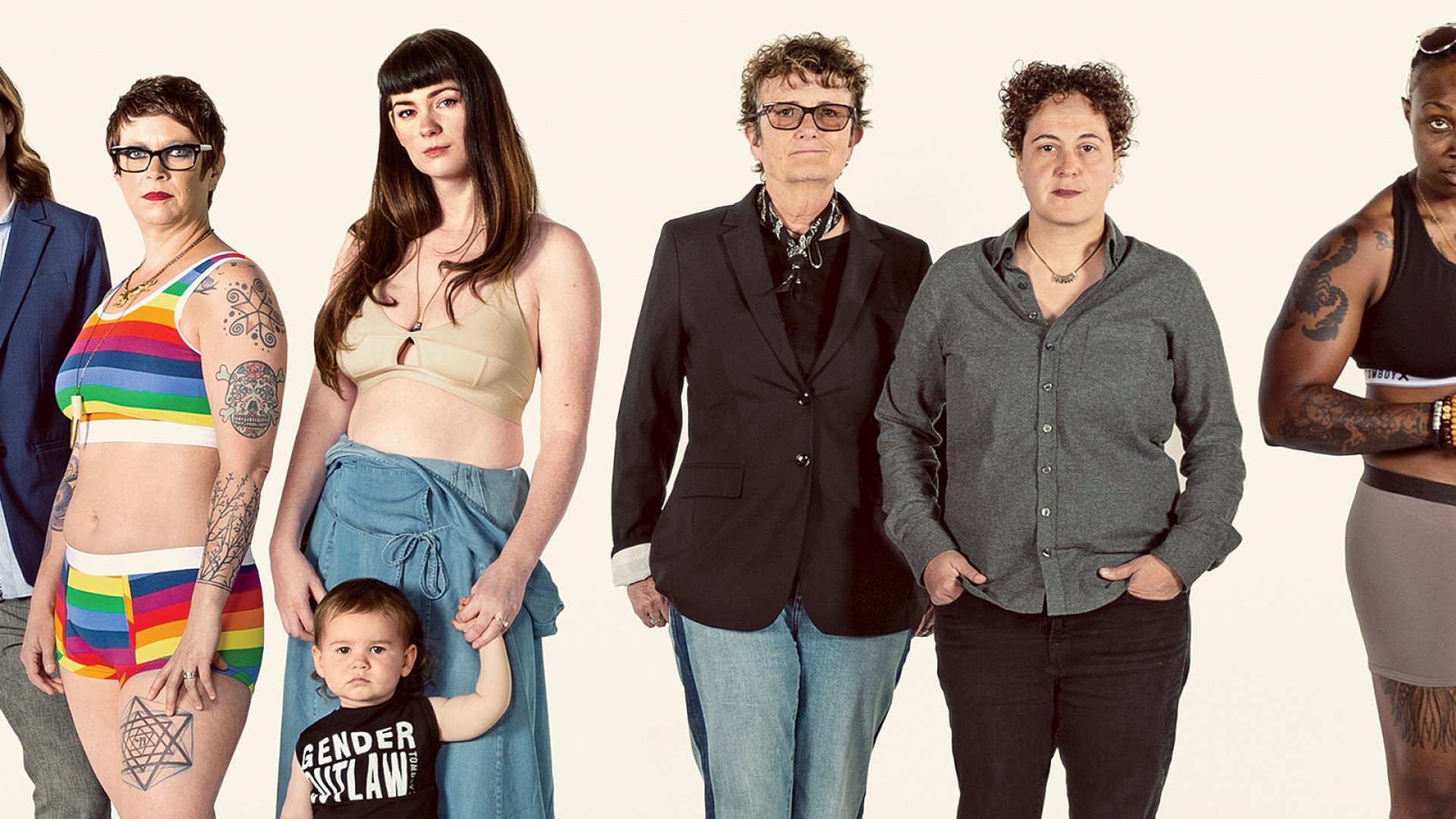 """Married co-founders Fran Dunaway (middle left) and Naomi Gonzalez (middle right) with TomboyX customers in their undergarments, including """"rainbow pride stripe"""" boy shorts."""