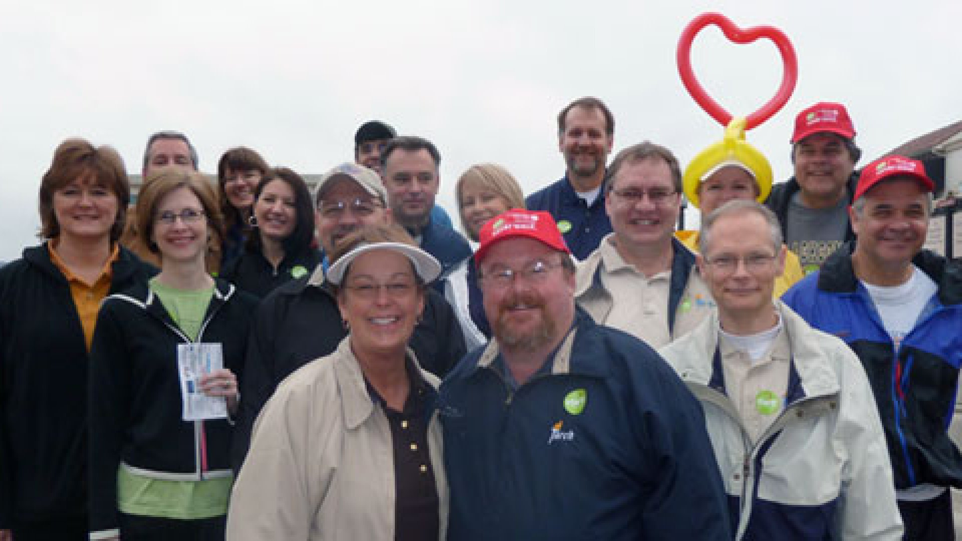 Employees join CEO Bill Roark and his wife Brenda (front) for the Torch Technologies team at the 2011 American Heart Association walk.