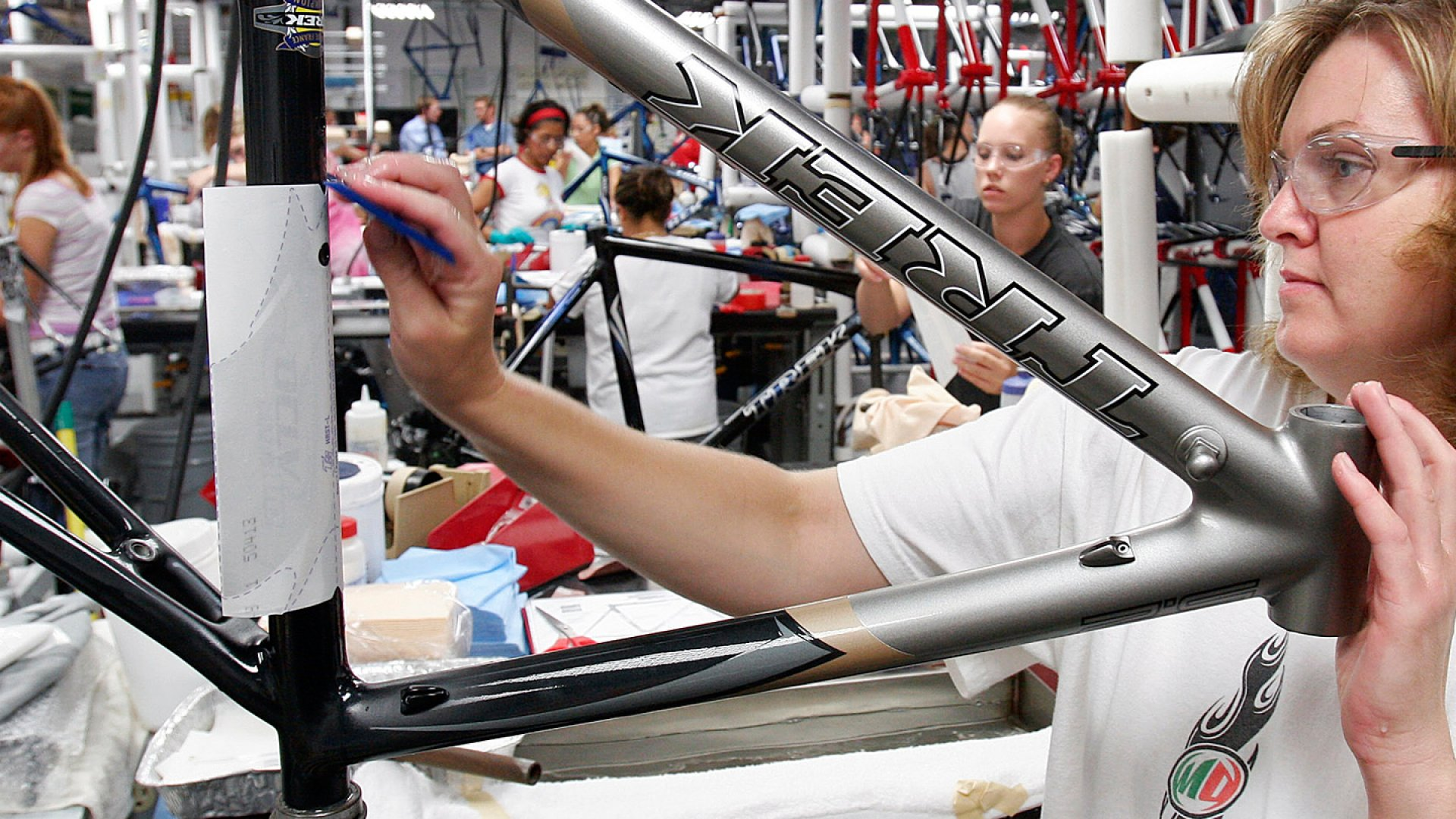 Justine Winter, right, applies a decal to a bicycle frame at the Trek Bicycle Corp. in Wisconsin