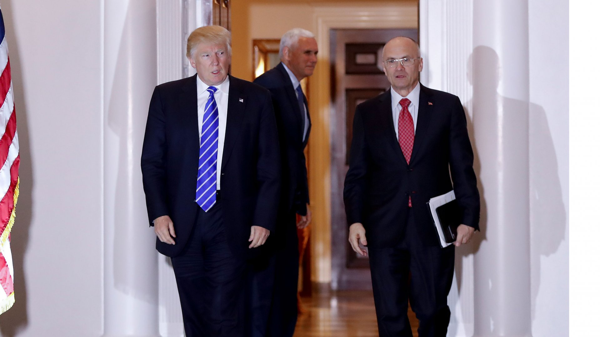 President-elect Donald Trump walks with CKE Restaurants CEO Andy Puzder from Trump National Golf Club Bedminster clubhouse in Bedminster, N.J. Trump is expected to add another wealthy business person and elite donor to his Cabinet, with fast food executive Andrew Puzder as Labor secretary.