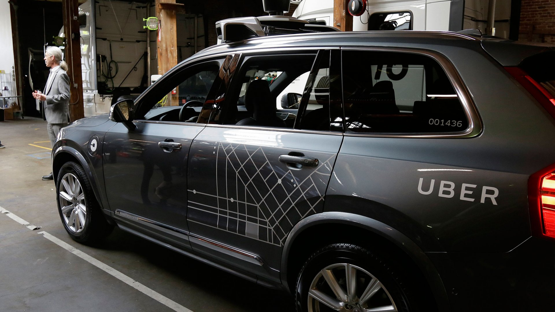 An Uber driverless car is displayed in a garage in San Francisco. Uber is bringing a small number of self-driving cars to its ride-hailing service in San Francisco - a move likely to both excite the city's tech-savvy population and spark a conflict with California regulators. The Wednesday, Dec. 14, launch in Uber's hometown expands a public pilot program the company started in Pittsburgh in September.