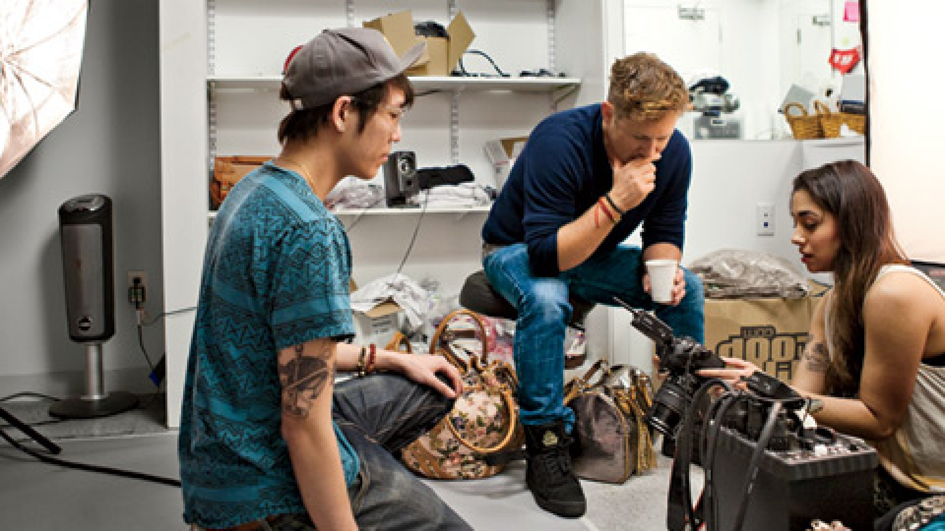 <b>Curator in Chief</b> Greg Selkoe (center), photographer Jackie Earhart, and her assistant, Tommy Vo, check out some product shots.