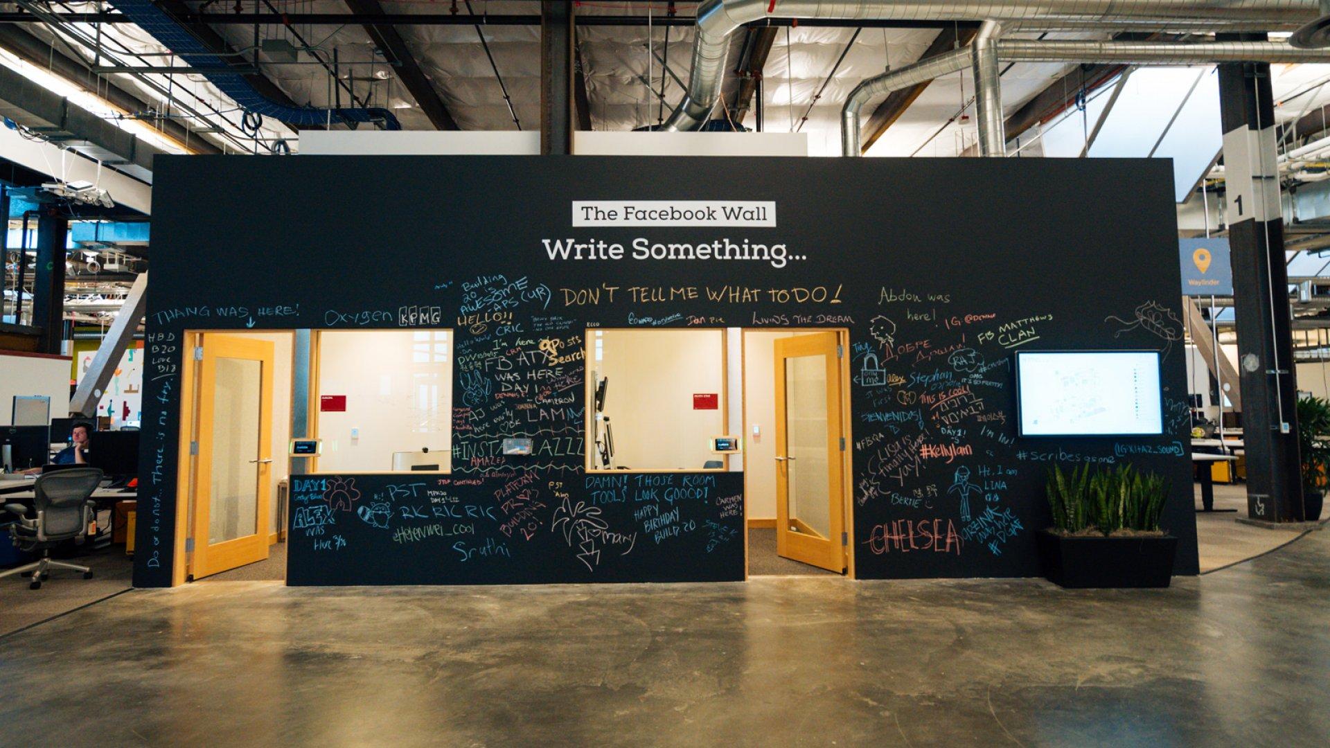 A message wall greets visitors at Facebook HQ.