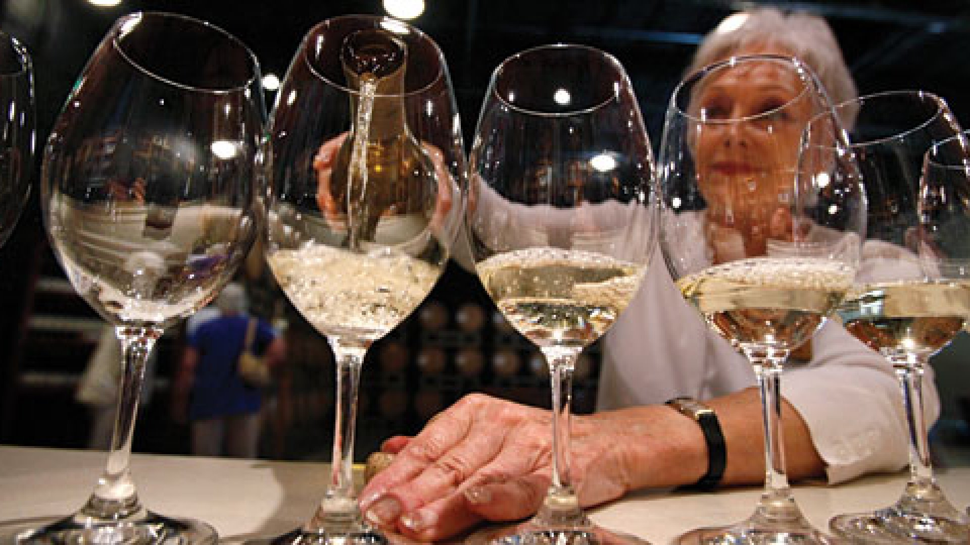 In this Aug. 26, 2010 photo, Elizabeth Richardson pours wine for a tour group at the Chateau Ste. Michelle winery in Woodinville, Wash. Hong Kong and mainland China are developing a strong thirst for wine and Washington and Oregon are hoping for a taste of those markets.