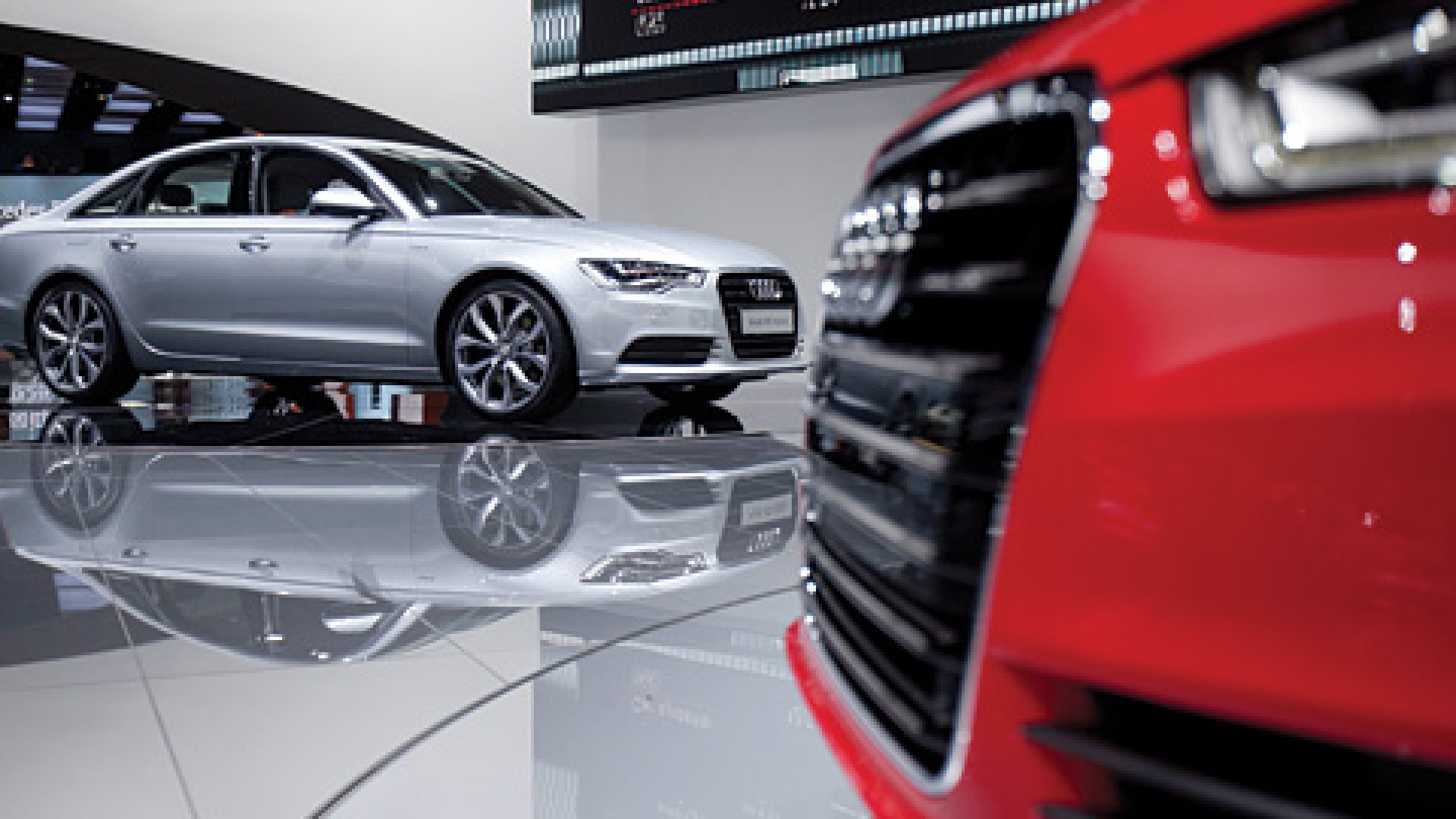 The 2012 Audi AG A6 sedan, right, and Audi A6 Hybrid sit on display at the North American International Auto Show (NAIAS) in Detroit, Michigan.