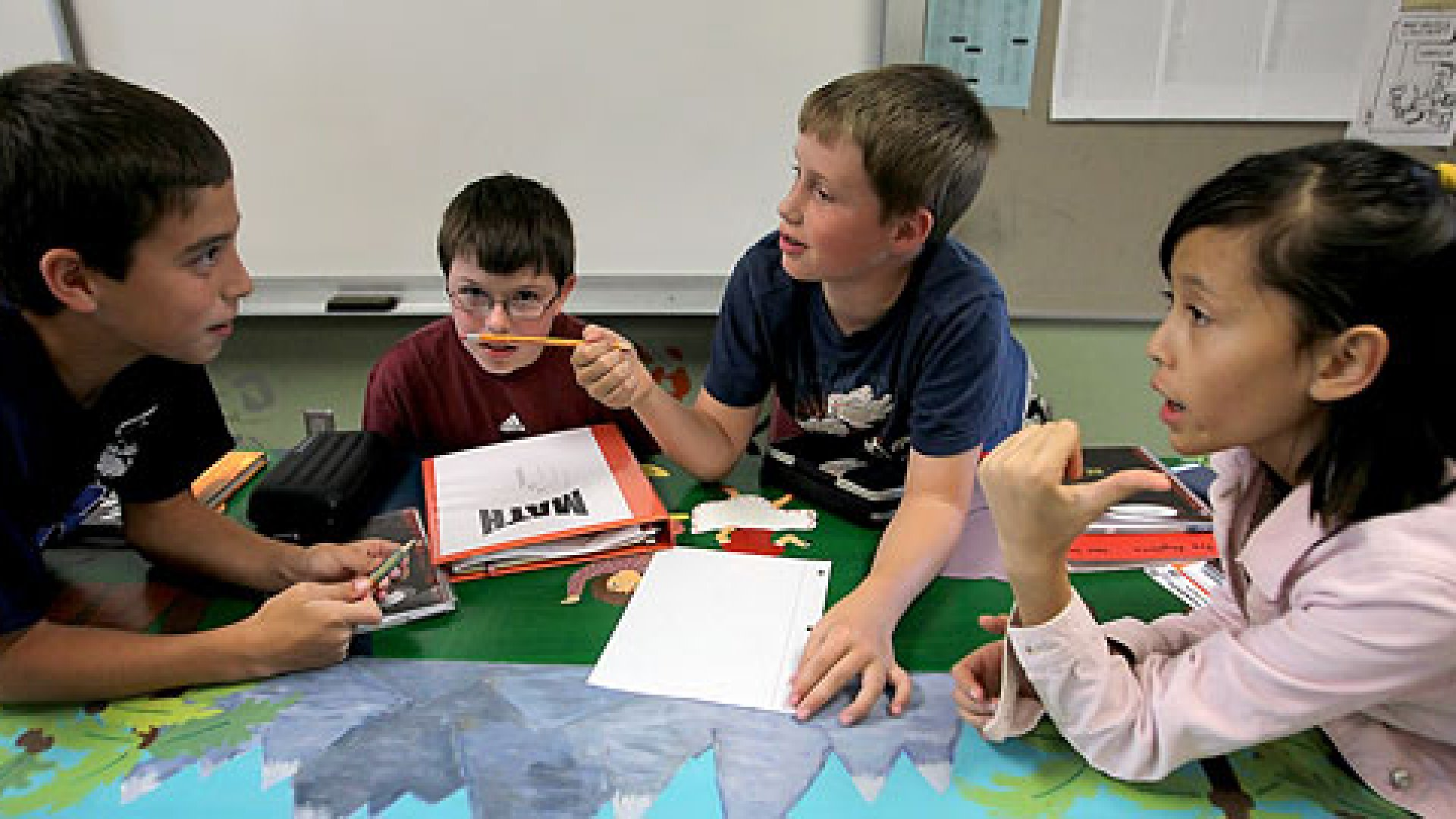 Sixth-graders Adam LeMay, 14, left, Grant Sunderman, 12, John Sampson, 11, and Jade Arrowsmith, 11, try to figure out math methods for their assignment in class.