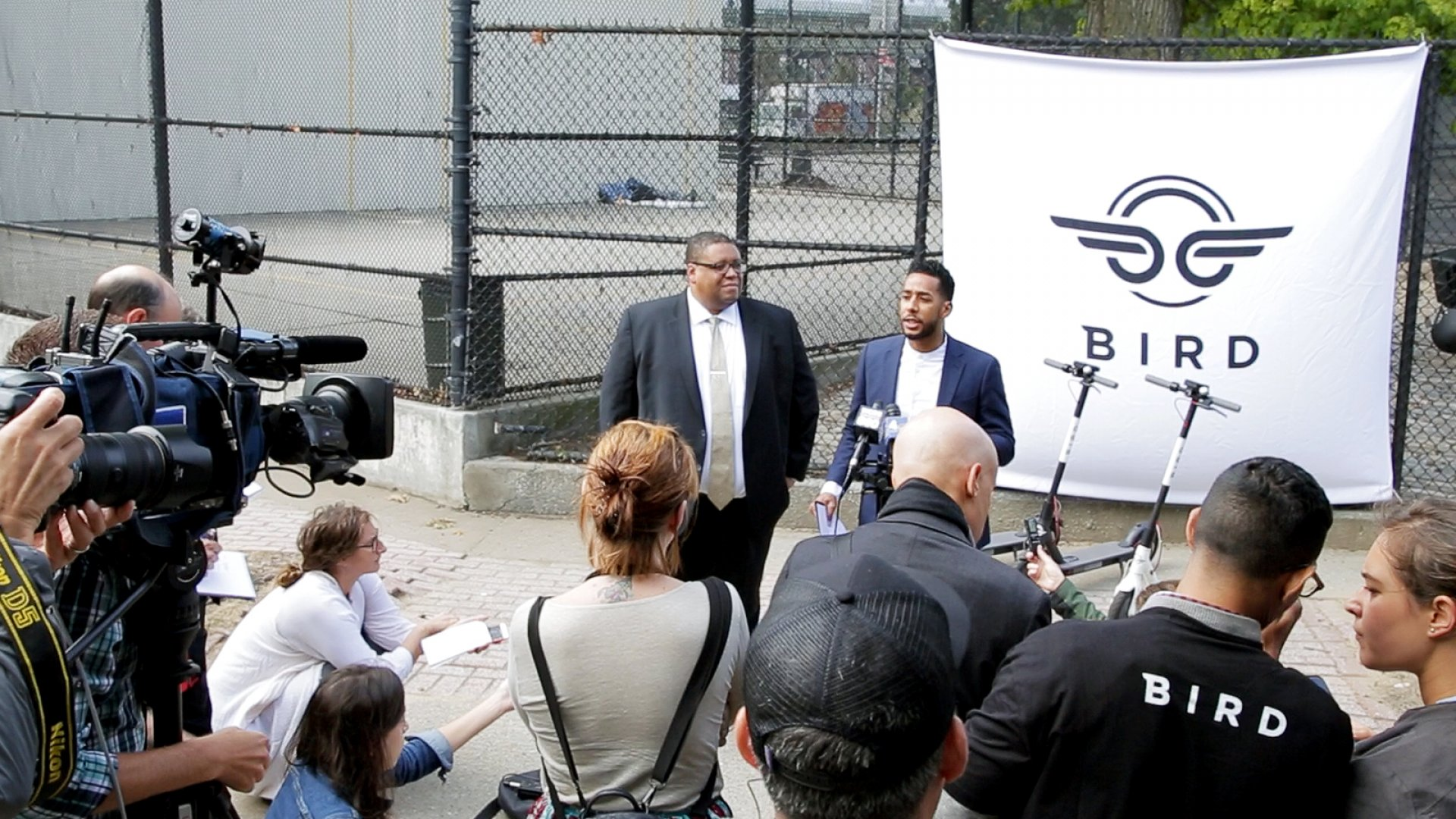 The head of Bird global safety advisory board David Strickland, left, and New York City Council member Antonio Reynoso, right, advocate for New York to change its laws to legalize e-scooters at a press conference in Williamsburg, Brooklyn on Sept. 24, 2018.