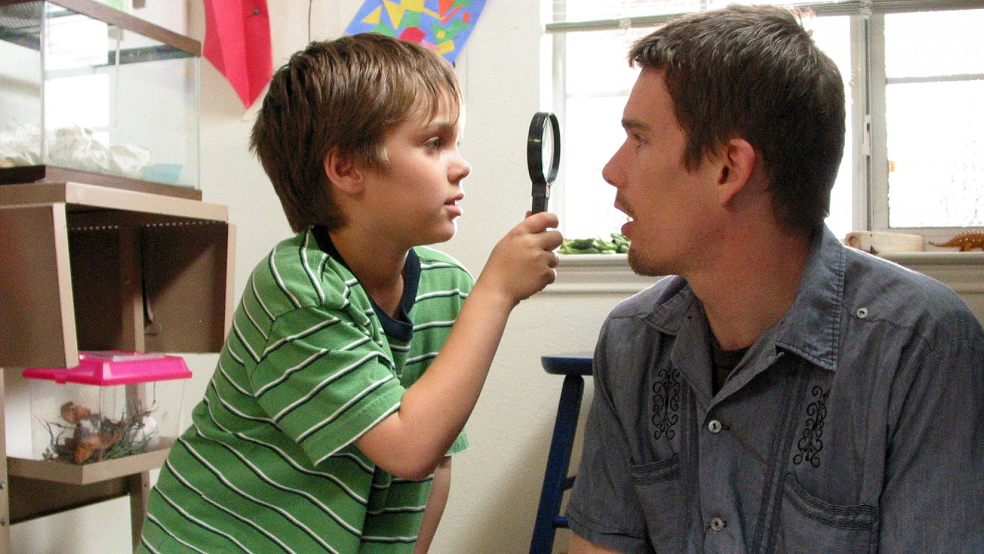 From left: Ellar Coltrane, Ethan Hawke in <i>Boyhood</i>.