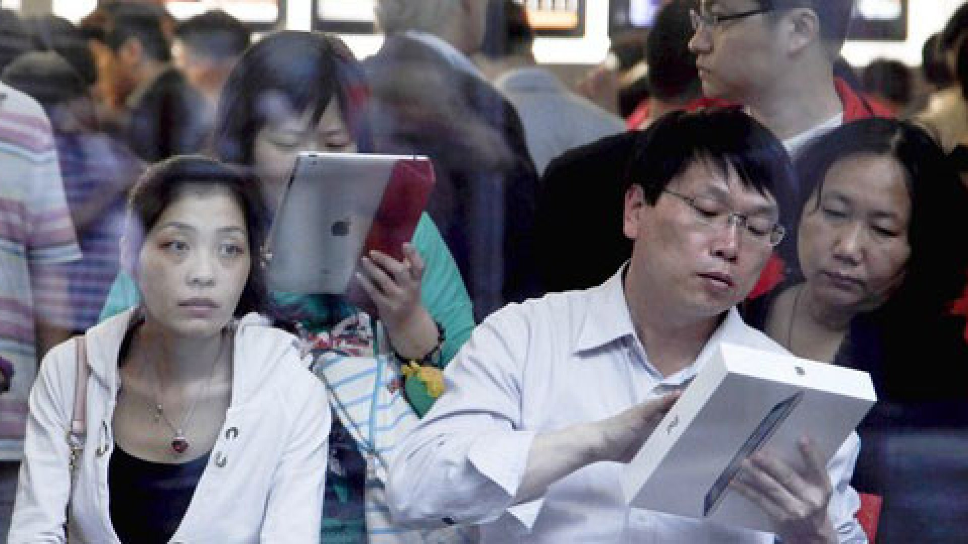 Chinese shoppers check out the iPad 2 at an Apple store in Beijing.