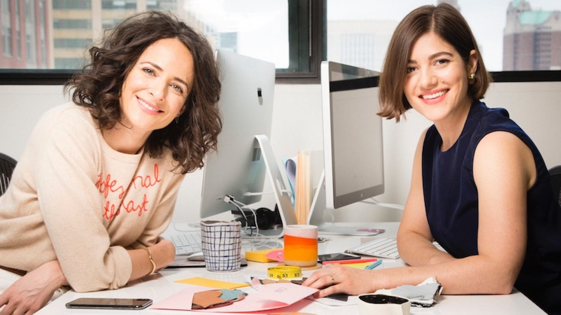"Claire Mazur and Erica Cerulo, the co-founders of Of a Kind, at their ""couples desk."""