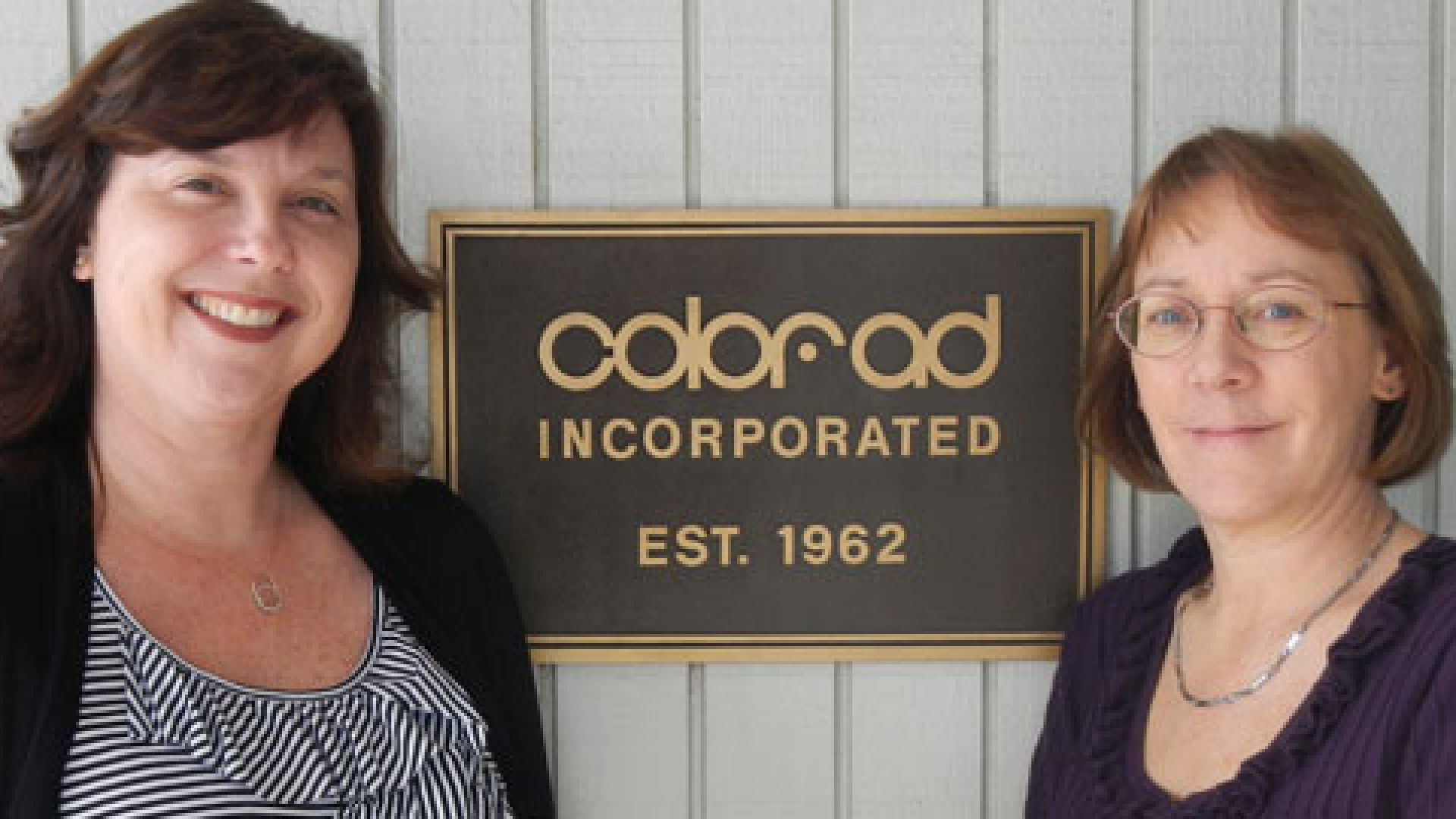 Majority owners of Color-Ad Dawn Bures (right) and sister-in-law Julie Velke.