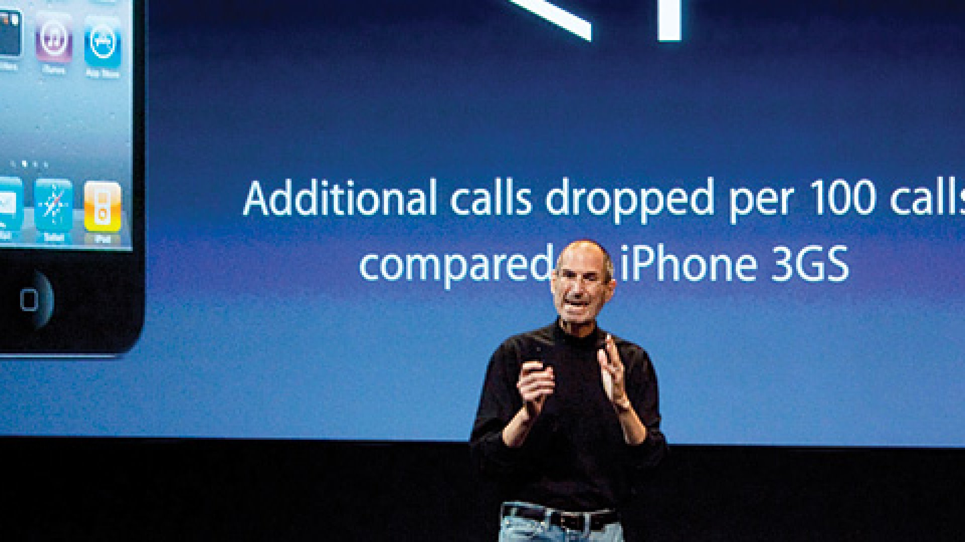 Steve Jobs speaking at a press conference for Apple's iPhone 4