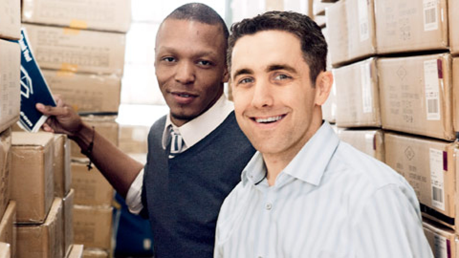 <b>Out of the Box </b>Daniel Hughes (right) runs StorageByMail with Maurice Riley, the company's chief marketing officer and sole employee.