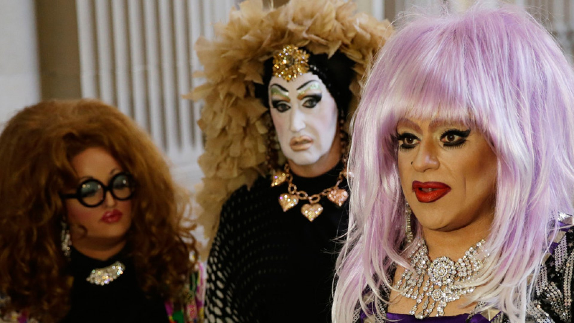 Drag queens from left, Lil Ms. Hot Mess, Sister Roma, and Heklina take turns speaking about their battle with Facebook during a news conference at City Hall Wednesday, Sept. 17, 2014, in San Francisco, California.