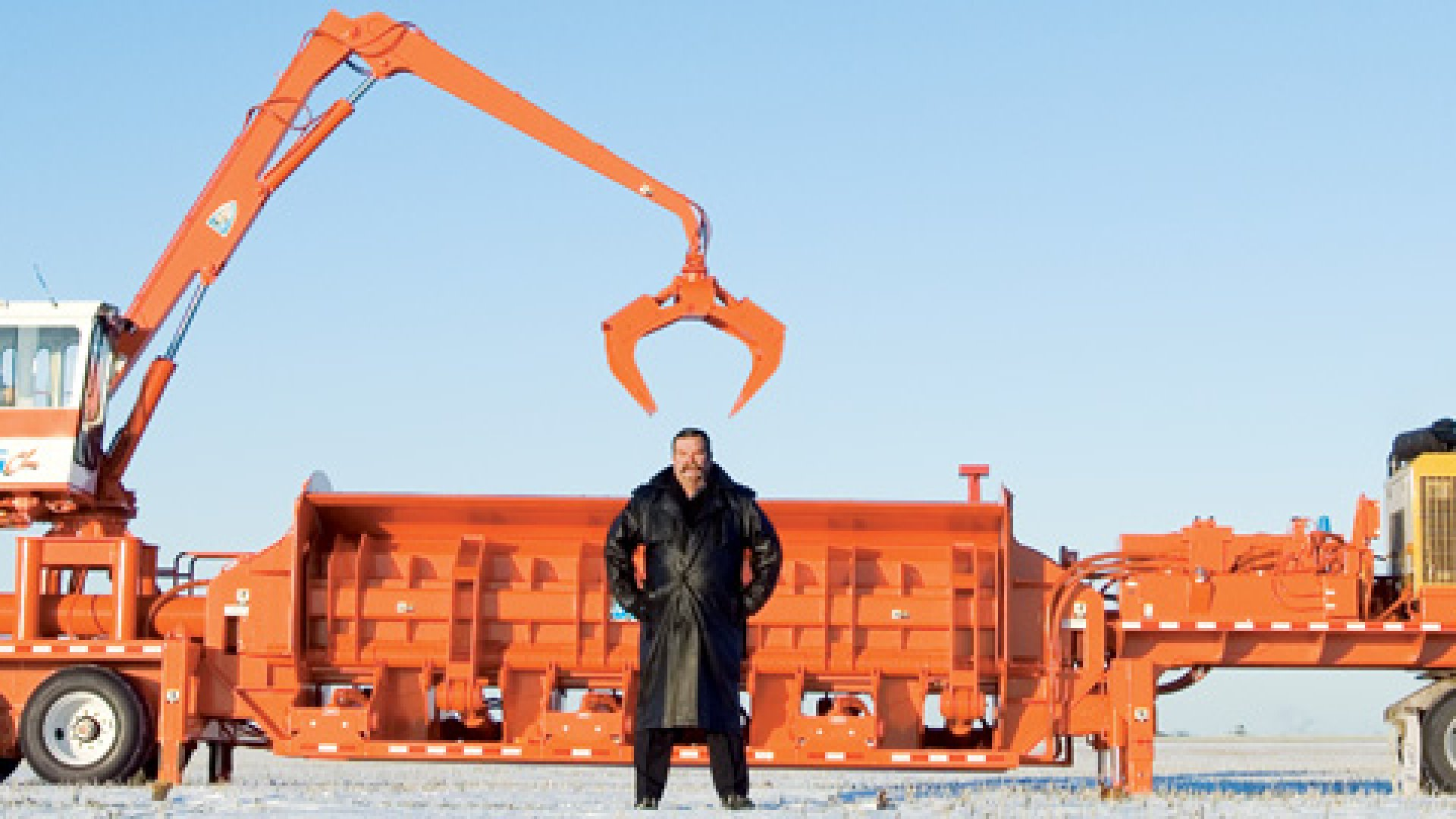 <strong>BIG ENOUGH FOR THE JOB</strong> Kendig Kneen stands with one of his car balers