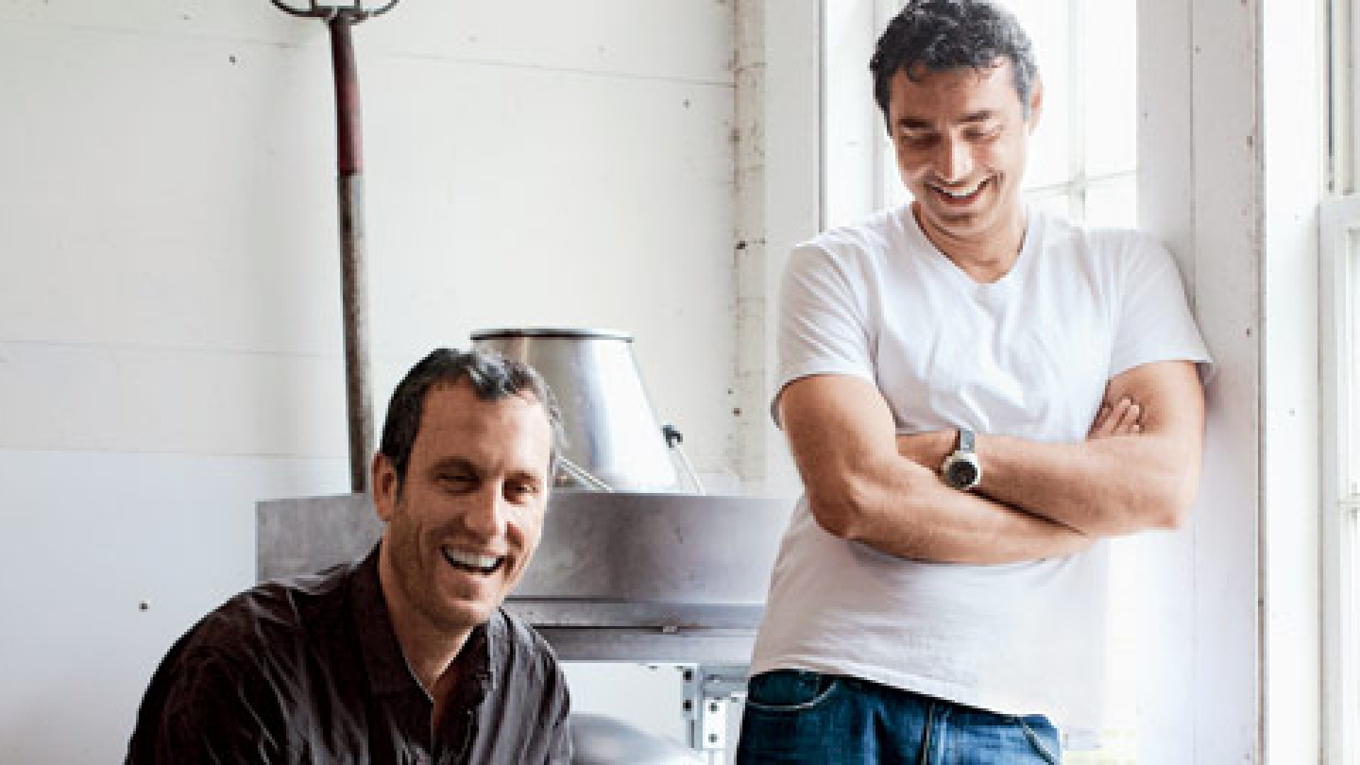 <b>Plan B </b>Promethean co-founders Sam White, left, and Sorin Grama, CEO, with their reconfigured milk chiller on a farm in Massachusetts.